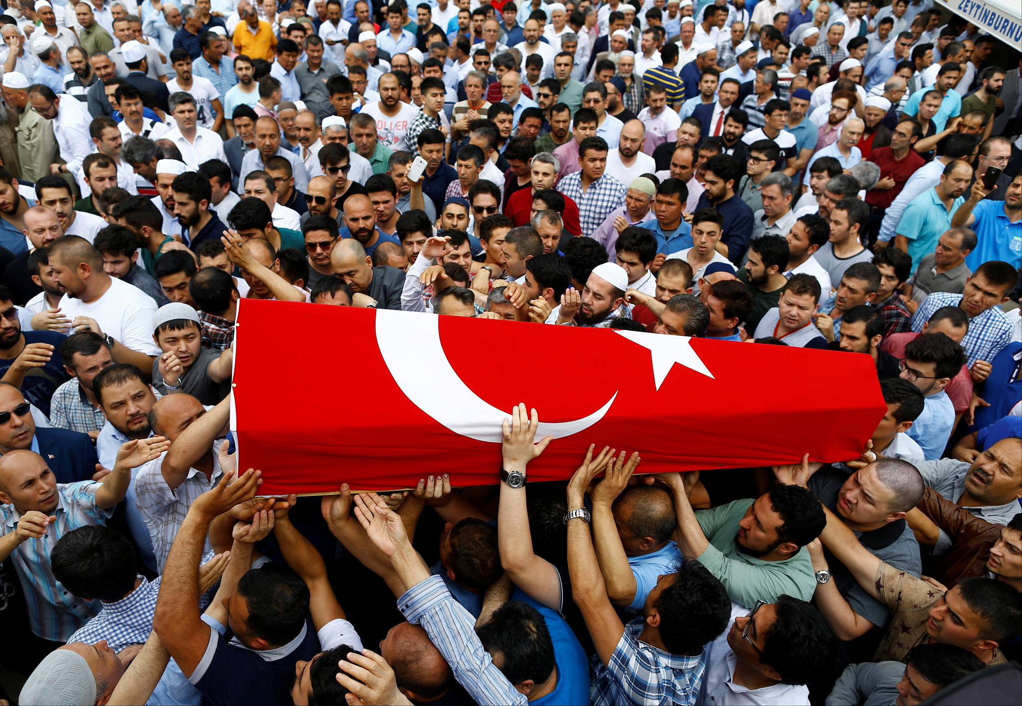 Friends and relatives of Habibullah Sefer, who was killed in Tuesday's attack at Istanbul airport, carry his flag-draped coffin during his funeral ceremony in Istanbul, Turkey