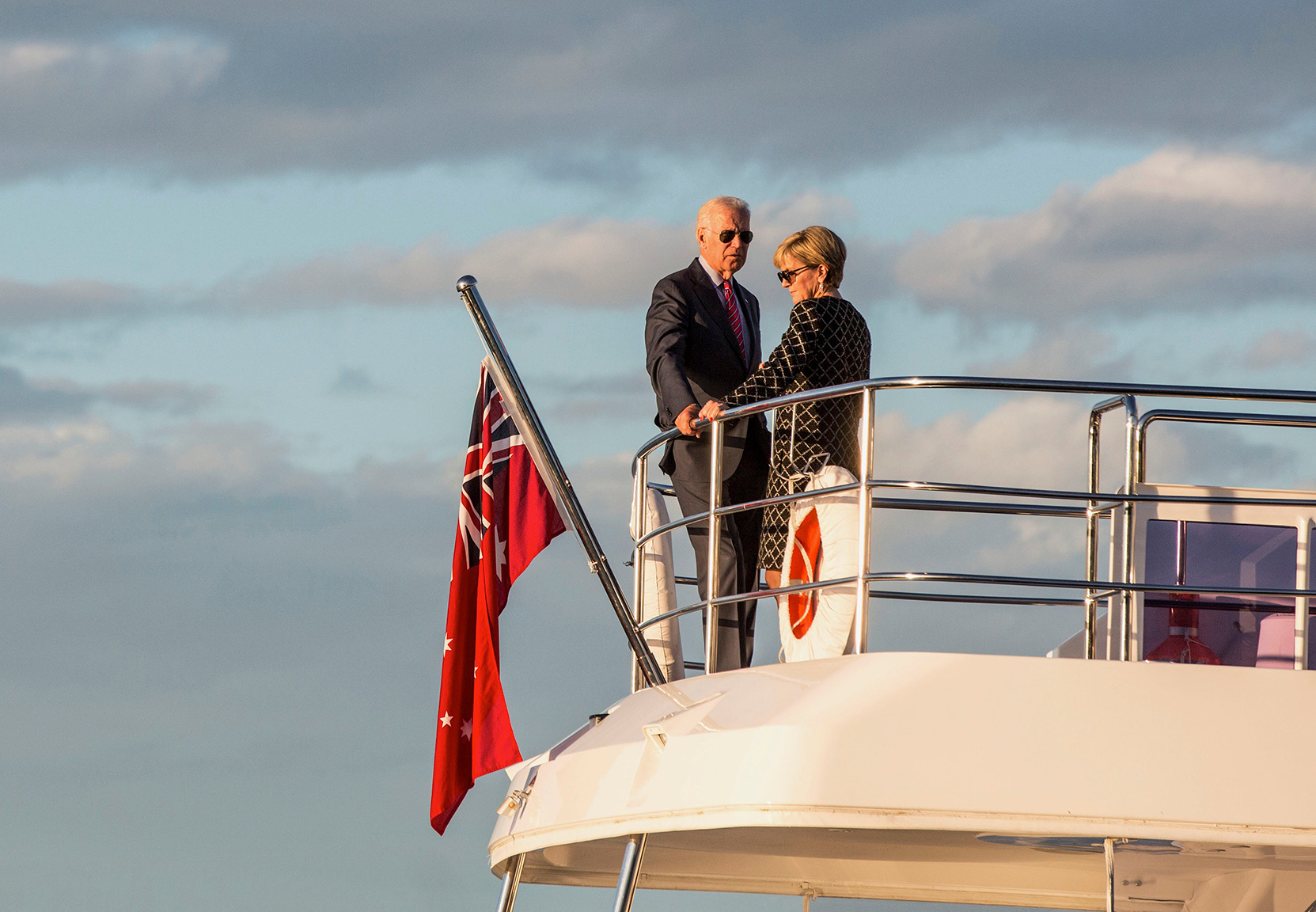 U.S. Vice President Joe Biden talks with Australian Foreign Affairs Minister Julie Bishop as they stand on a boat at sunset on Sydney Harbour