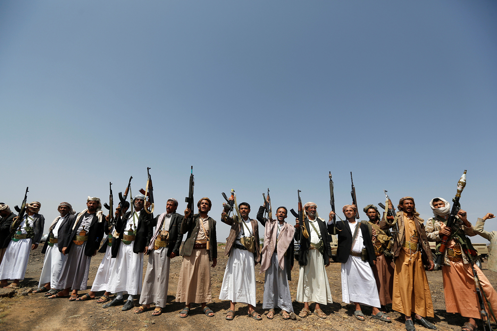 Tribesmen loyal to the Houthi movement hold up their rifles as they shout slogans during a pro-Houthi tribal gathering in a rural area near Sanaa, Yemen