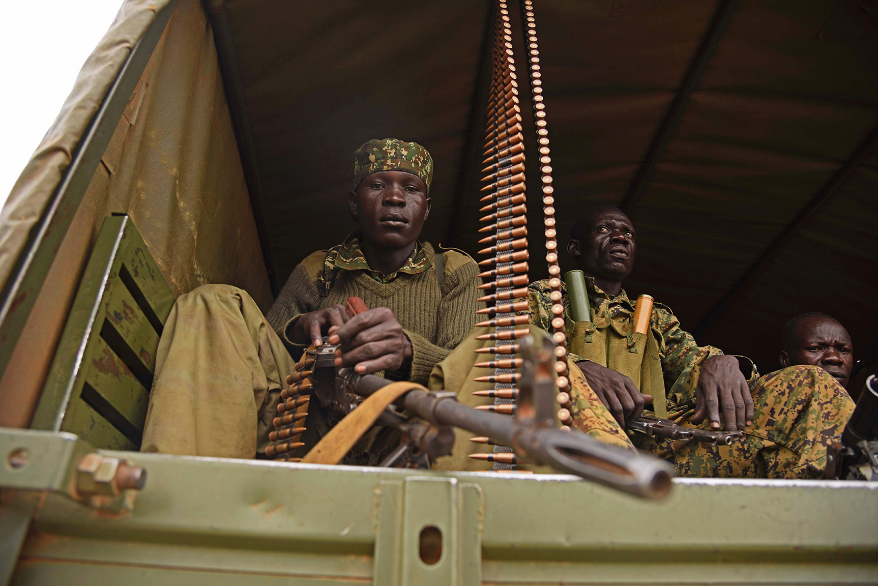 Uganda military personnel are seen atop