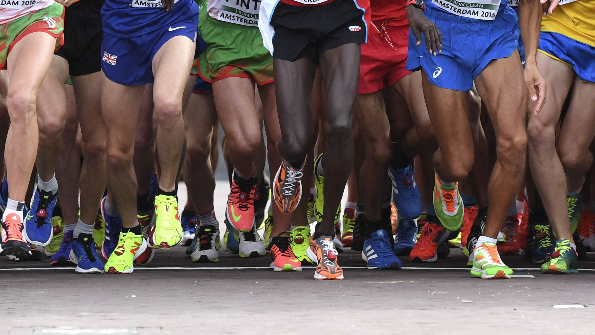 Athletes leave the start at the men's half marathon final during the European Athletics Championships in Amsterdam, the Netherlands