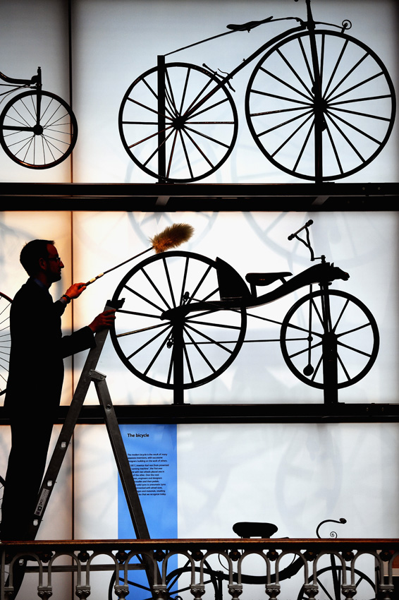 EDINBURGH, SCOTLAND - JULY 05:  Dr Sam Alberti, dusts some bicycles during the opening of a major new development at the National Museum of Scotland on July 5, 2016 in Edinburgh,Scotland. The National Museum of Scotland today opened ten new galleries devoted to science, art and design, as part of £14.1m project which increased its exhibition space by almost half and putting many treasures from its collections on display for the first time.  (Photo by Jeff J Mitchell/Getty Images)