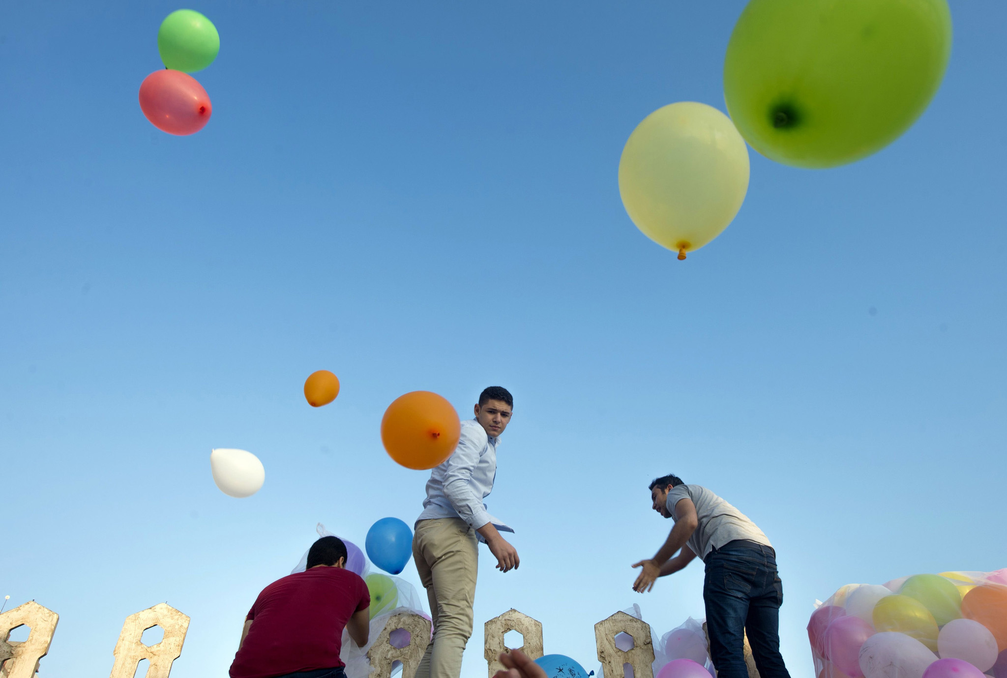 Egyptian Muslims release balloons from the roof top of a mosque at the end of prayers on the first day of Eid al-Fitr holiday that marks the end of the holy fasting month of Ramadan on July 6, 2016 in the Nile Delta city of Mansura, some 120 kms north of Cairo.  Muslims worldwide celebrate Eid al-Fitr marking the end of the fasting month of Ramadan.  / AFP PHOTO / KHALED DESOUKIKHALED DESOUKI/AFP/Getty Images