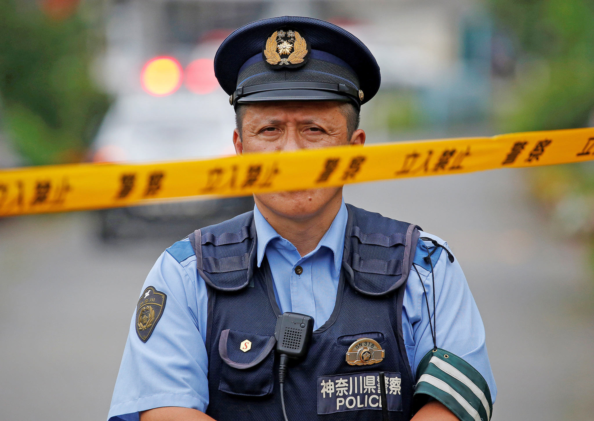 A police officer stands guard near a facility for the disabled, where a deadly attack by a knife-wielding man took place, in Sagamihara, Kanagawa prefecture, Japan, July 26, 2016