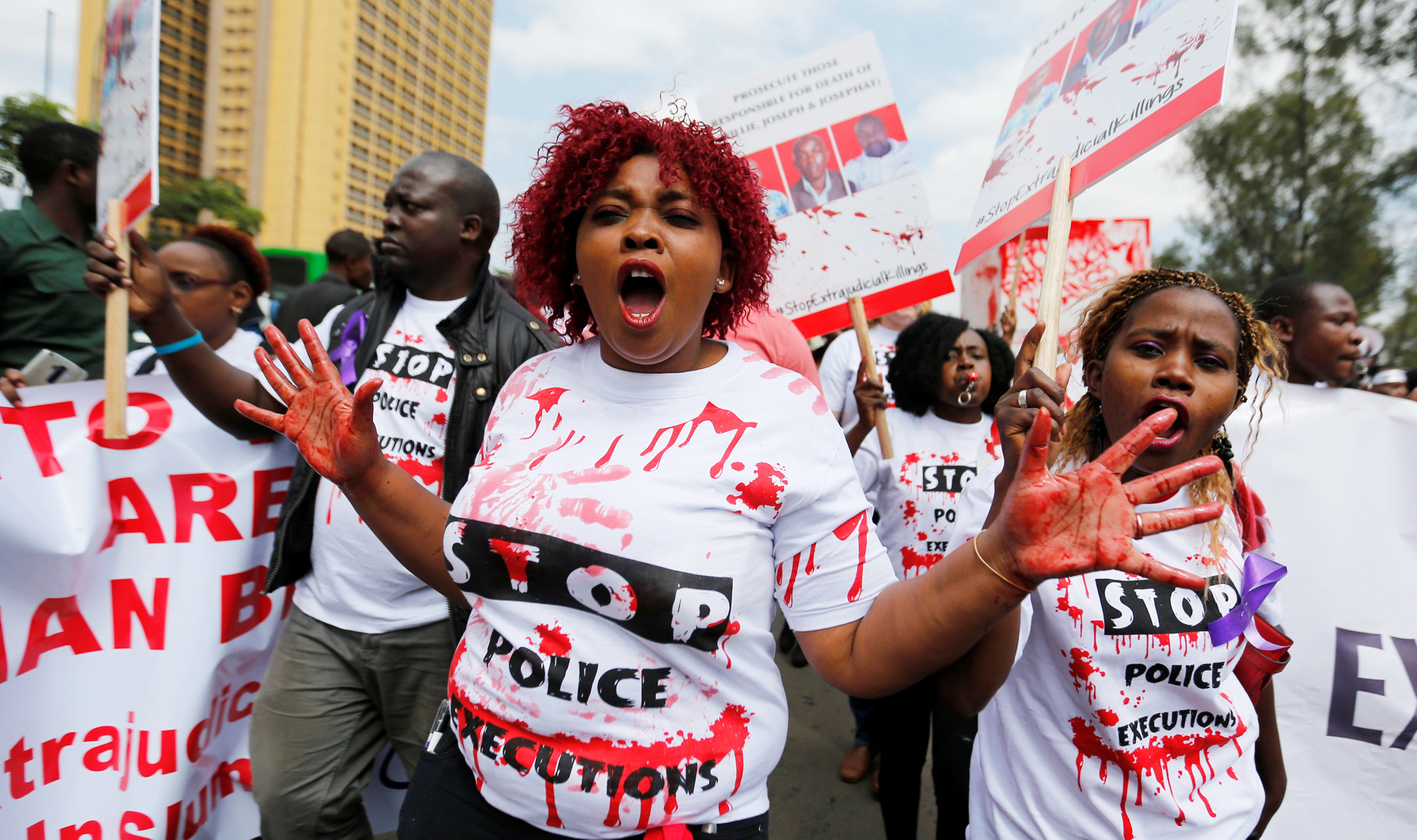 "A member of the civil society chants slogans during a protest dubbed ""Stop extrajudicial killings"" on the killing of human rights lawyer, Willie Kimani, his client and their driver in Nairobi, Kenya, July 4, 2016. REUTERS/Thomas Mukoya"