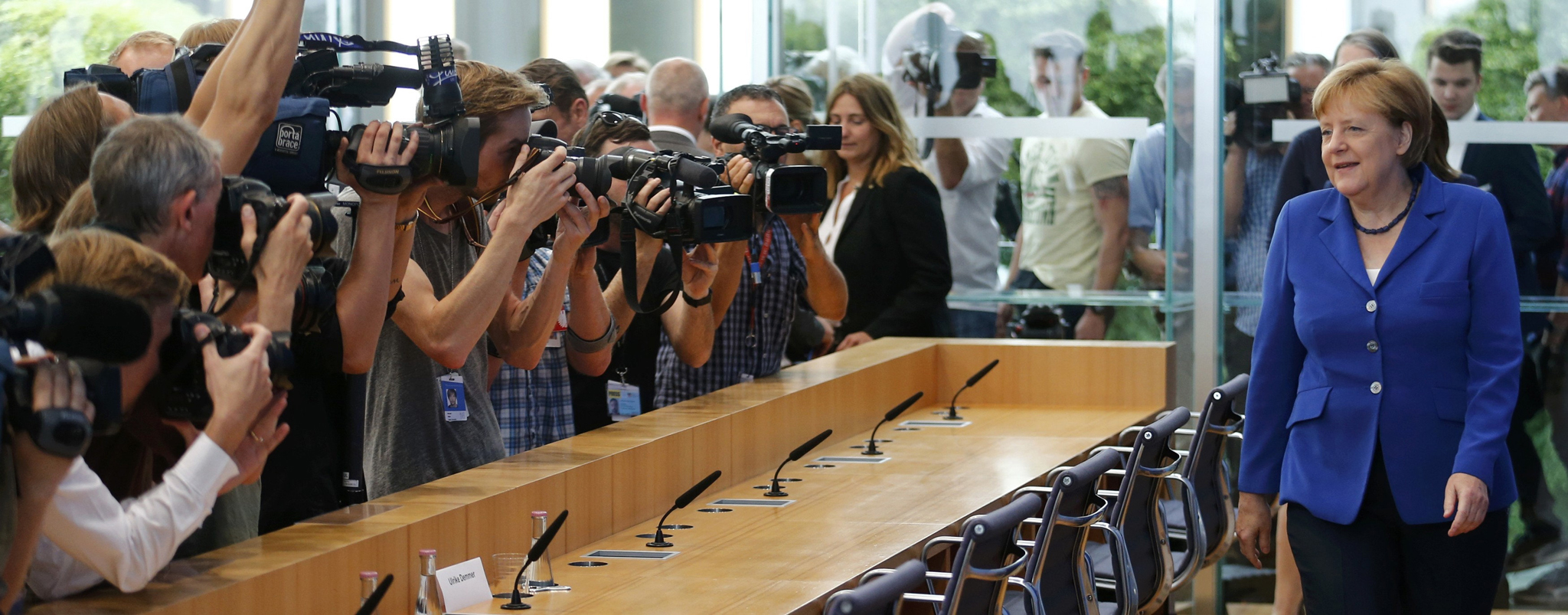 German Chancellor Angela Merkel arrives for a news conference in Berlin, Germany, July 28, 2016.