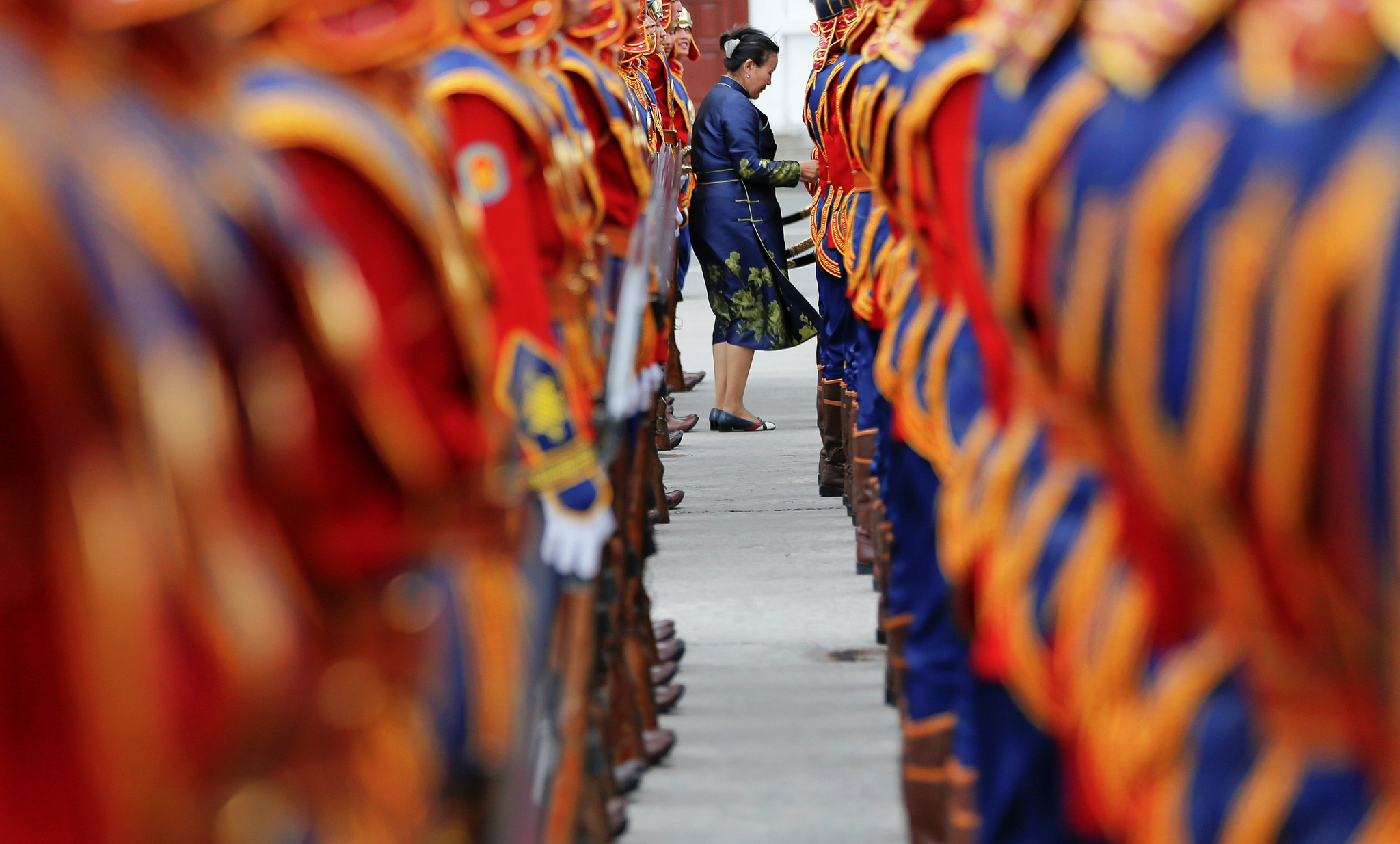 A woman checks uniforms of honour guards before a welcoming ceremony for Japan's Prime Minister Shinzo Abe at Genghis Square in central Ulaanbaatar, Mongolia, July 14, 2016. REUTERS/Damir Sagolj