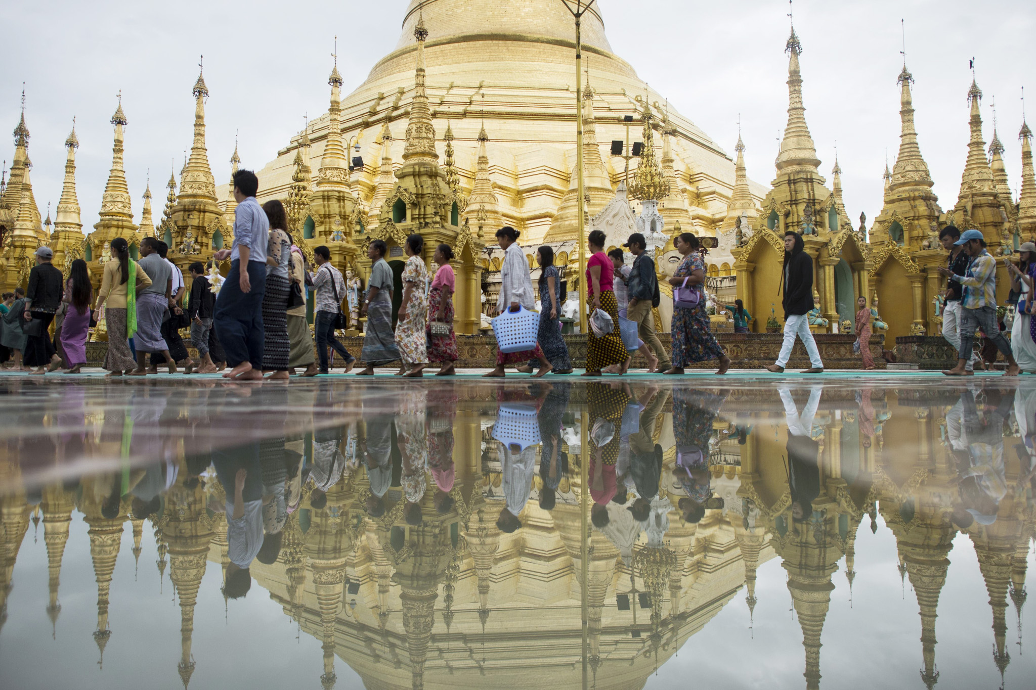 People visit Myanmar's landmark Shwedagon Pagoda in Yangon on July 14, 2016.  Around 89 percent of the population in Myanmar practice Buddhism, with the rest divided among Christians and Muslims.  / AFP PHOTO / YE AUNG THUYE AUNG THU/AFP/Getty Images