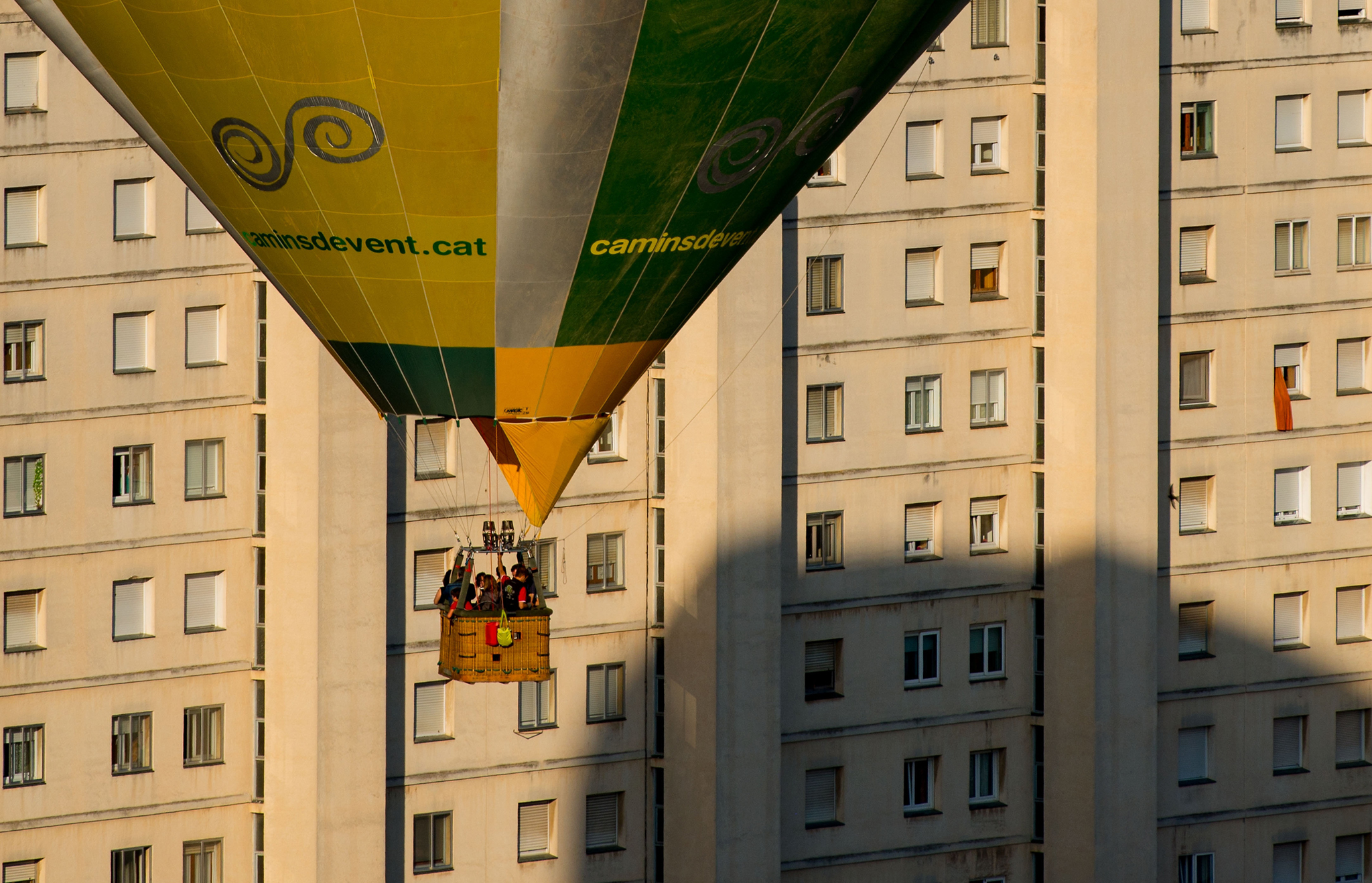 A hot air balloon flies over the city of Igualada on an early flight as part of the European Balloon Festival