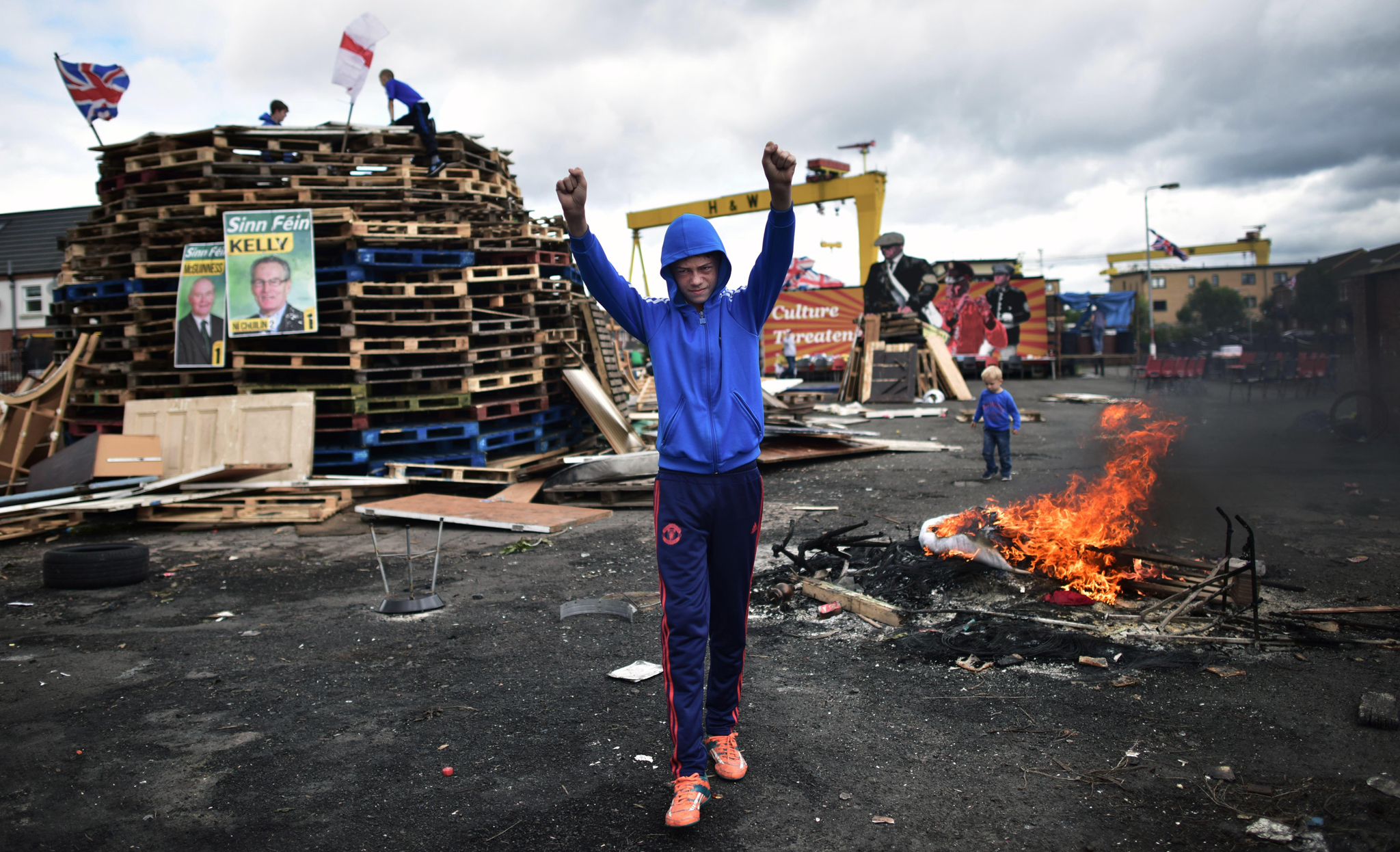 Loyalists make final preparations to their bonfire on the Newtownards road on July 11, 2016 in Belfast, Northern Ireland. The lighting of the bonfires at midnight on the eleventh night marks the start of the annual twelfth of July celebrations within the protestant community. The Orange marches and demonstrations celebrate the Battle of the Boyne in 1690 when the Protestant King William of Orange defeated the Catholic King James II on the banks of the river Boyne.