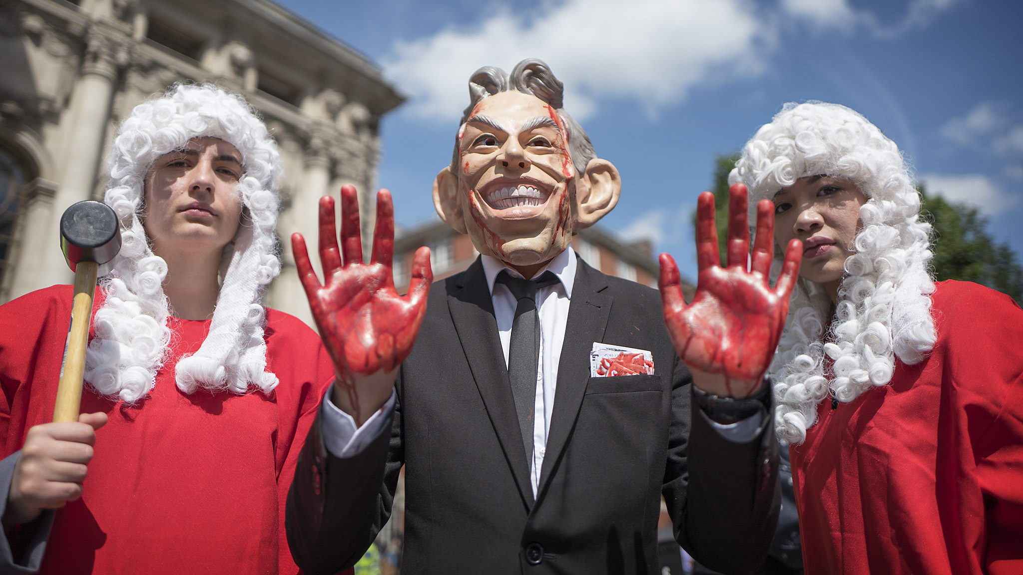 The Chilcot inquiry into Iraq reports.... A member of the stop the war coalition, dressed as Tony Blair, protest outside the Chilcot inquiry at the QE2 centre, central London.