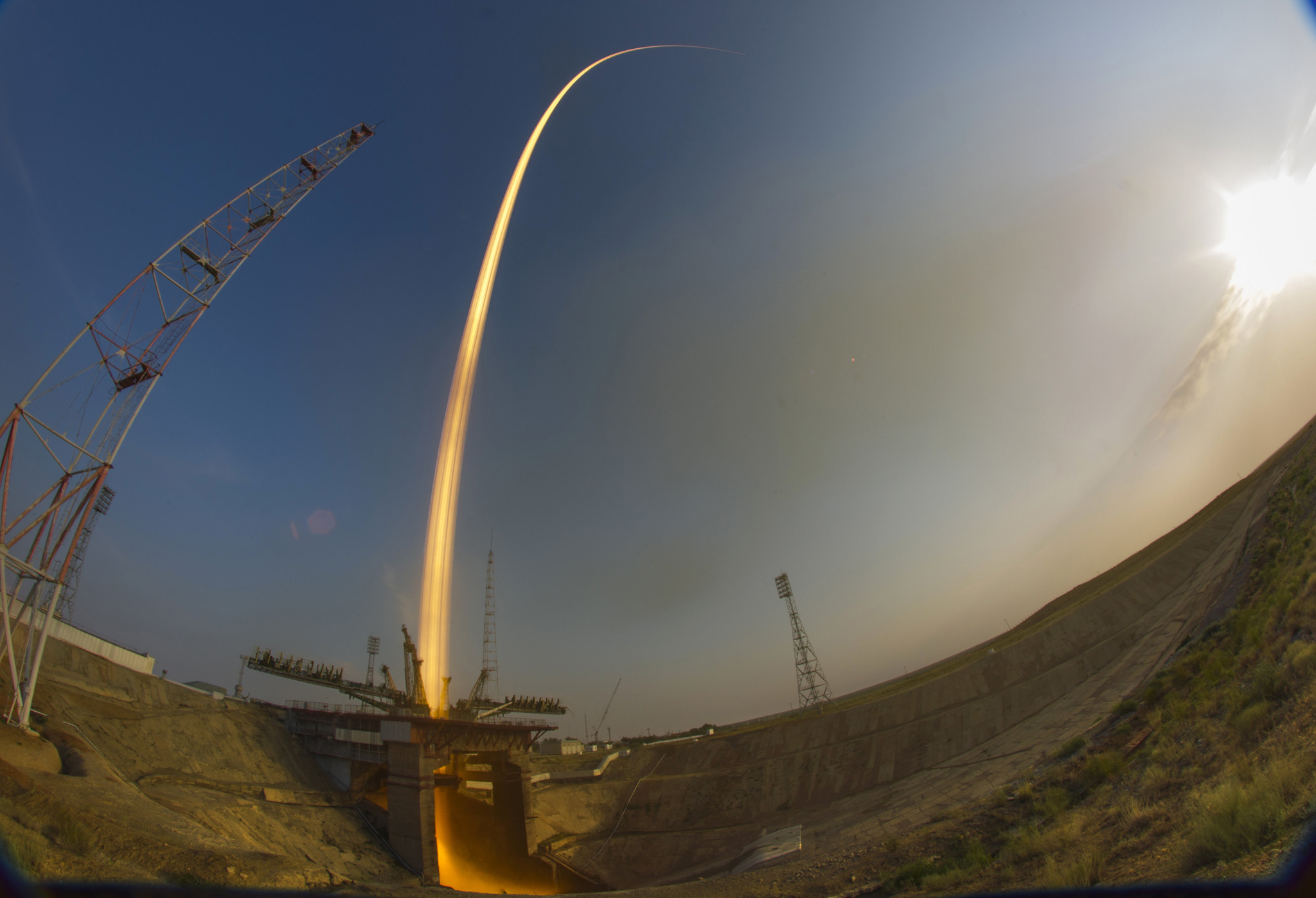 In this photo taken with a fisheye lens and with long time exposure, the Soyuz-FG rocket booster with Soyuz MS space ship carrying a new crew to the International Space Station, ISS, blasts off at the Russian leased Baikonur cosmodrome, Kazakhstan, Thursday, July 7, 2016. (AP Photo/Dmitri Lovetsky)