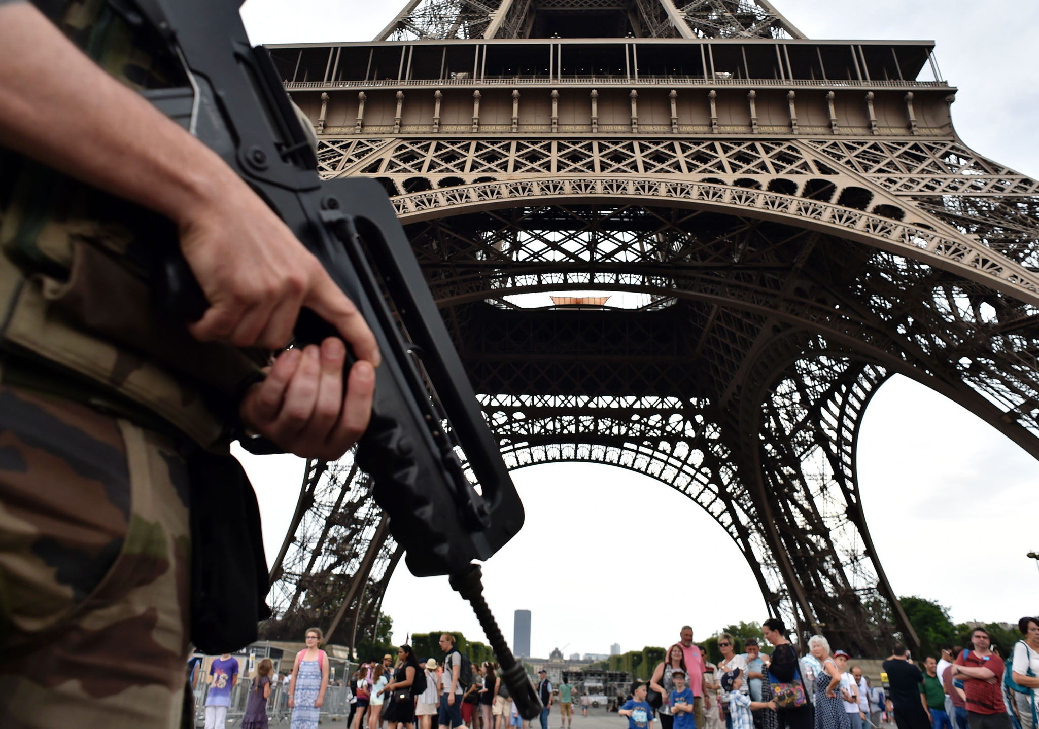 An armed French soldier of the 35th RAP (35e regiment d'artillerie parachutiste), part of Operation Sentinelle, patrols under at the Eiffel tower in Paris