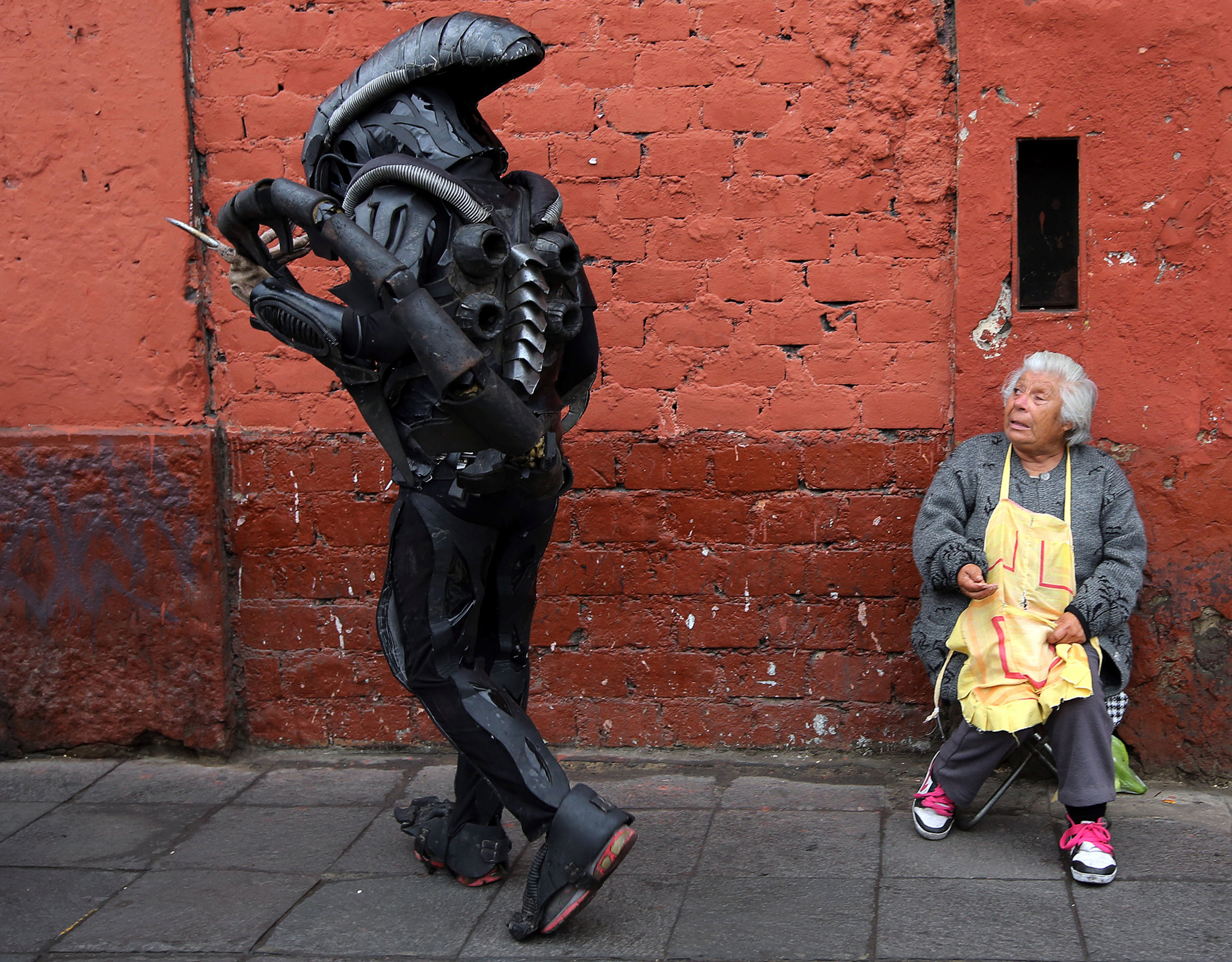A person dressed as in movie costume walks near Saint Rose's Church during celebrations of the anniversary of Santa Rosa de Lima, patroness of Latin America and the Philippines, in Lima