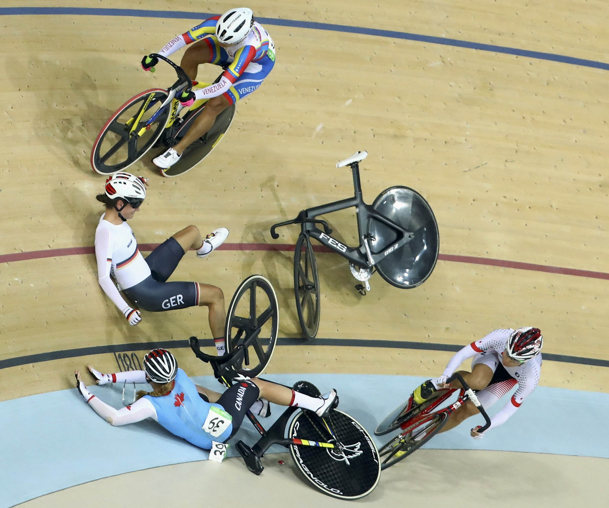 Anna Knauer of Germany and Allison Beveridge of Canada crash during the final of the Women's Omnium 10km Scratch Race