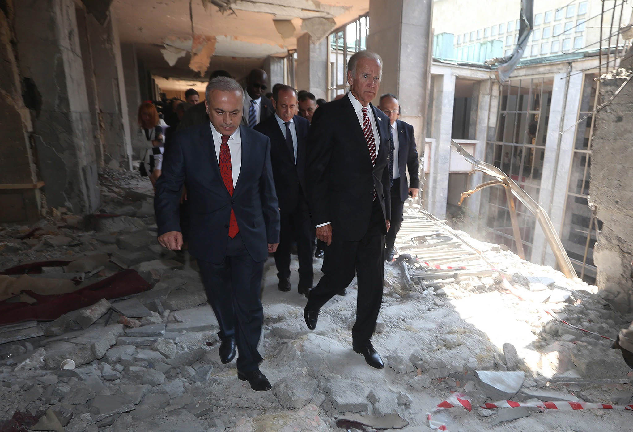 U.S Vice President Joe Biden (R) visits a destroyed part of the Turkish Parliament in Ankara, Turkey, 24 August 2016. Biden is on a one day visit to Turkey during which it is expected that the extradition of Fethullah Gulen will be one of the main topics. Turkey had requested the extradition of Gulen, whom they believe is the mastermind behind a failed coup on 15 July.  EPA/STR