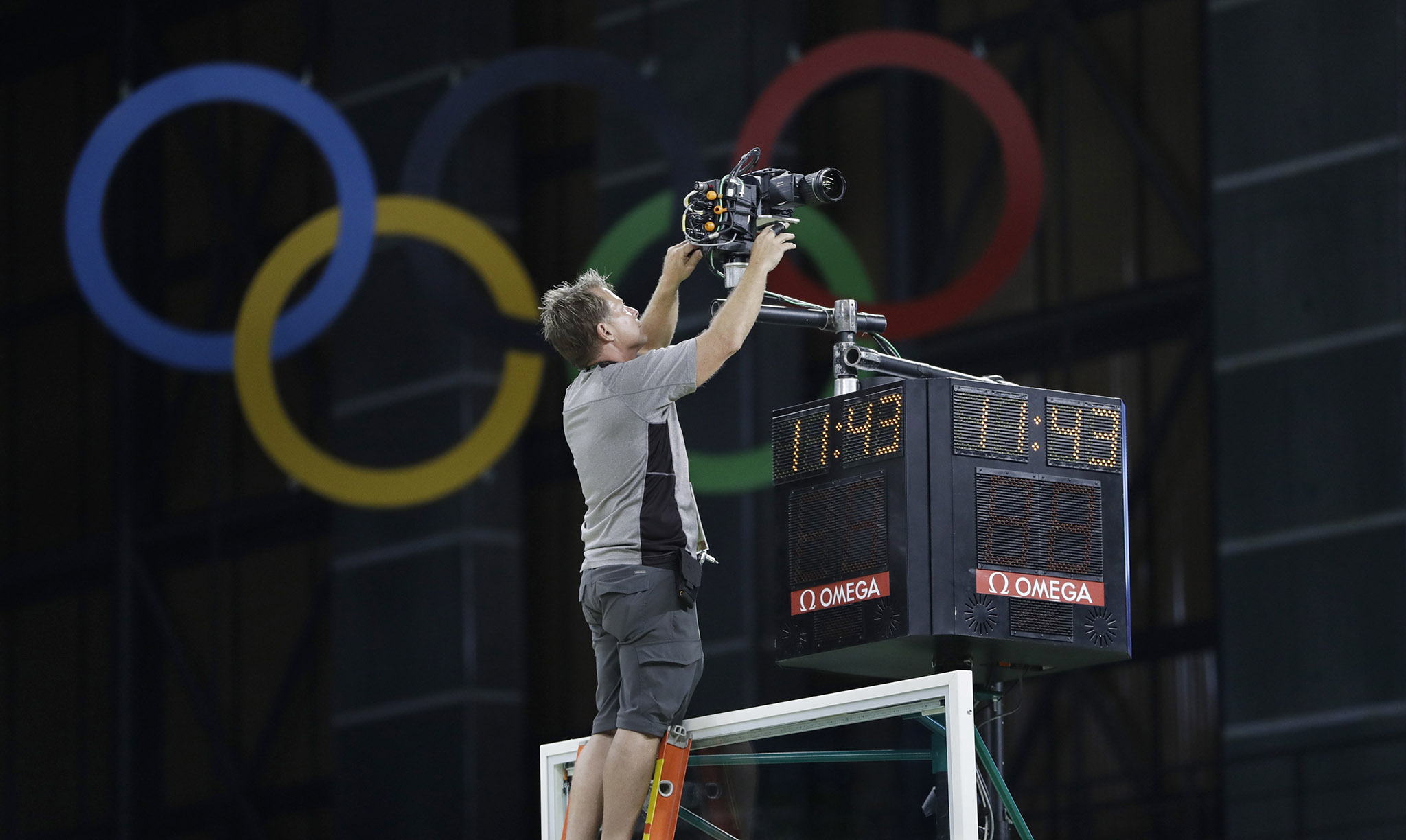 Technician Steven Heinz adjusts a remote camera during an off day for women's basketball at the Youth Center at the 2016 Summer Olympics in Rio de Janeiro, Brazil,