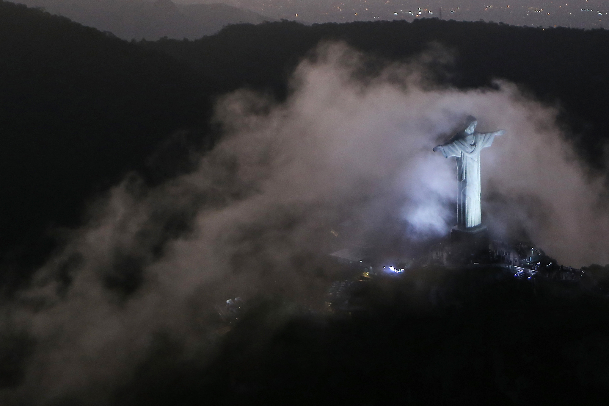 RIO DE JANEIRO, BRAZIL - JULY 31:  An aerial view of the Christ the Redeemer statue amidst mist as Rio prepares for the 2016 Summer Olympic Games on July 31, 2016 in Rio de Janeiro, Brazil.  (Photo by Mario Tama/Getty Images)