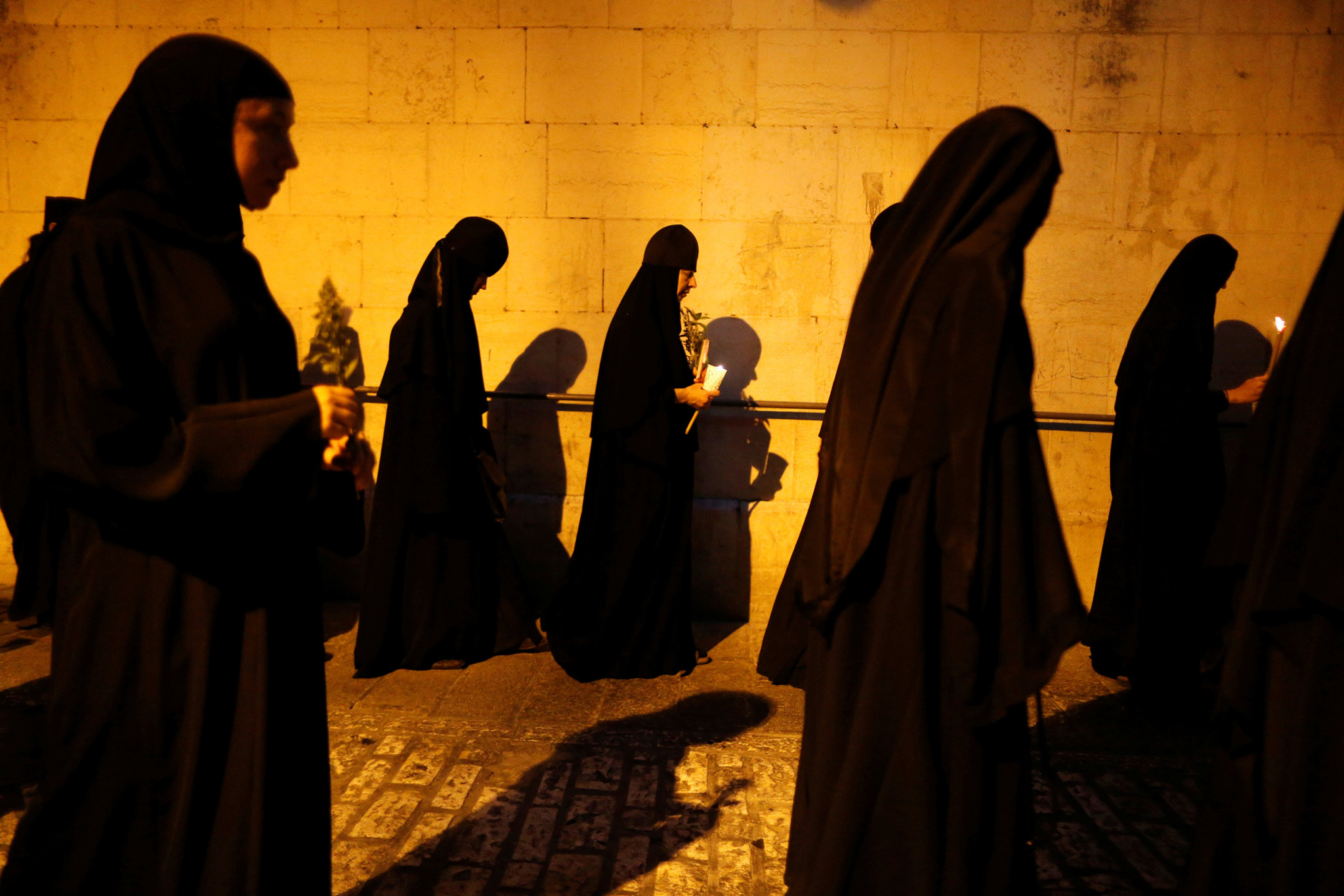 Orthodox Christian nuns take part in an annual procession along the Via Dolorosa in Jerusalem's Old City, during which an icon of the Virgin Mary is carried from the Church of the Holy Sepulchre to a church at the foot of the Mount of Olives, the location believed by Christians to be that of the tomb of the Virgin Mary