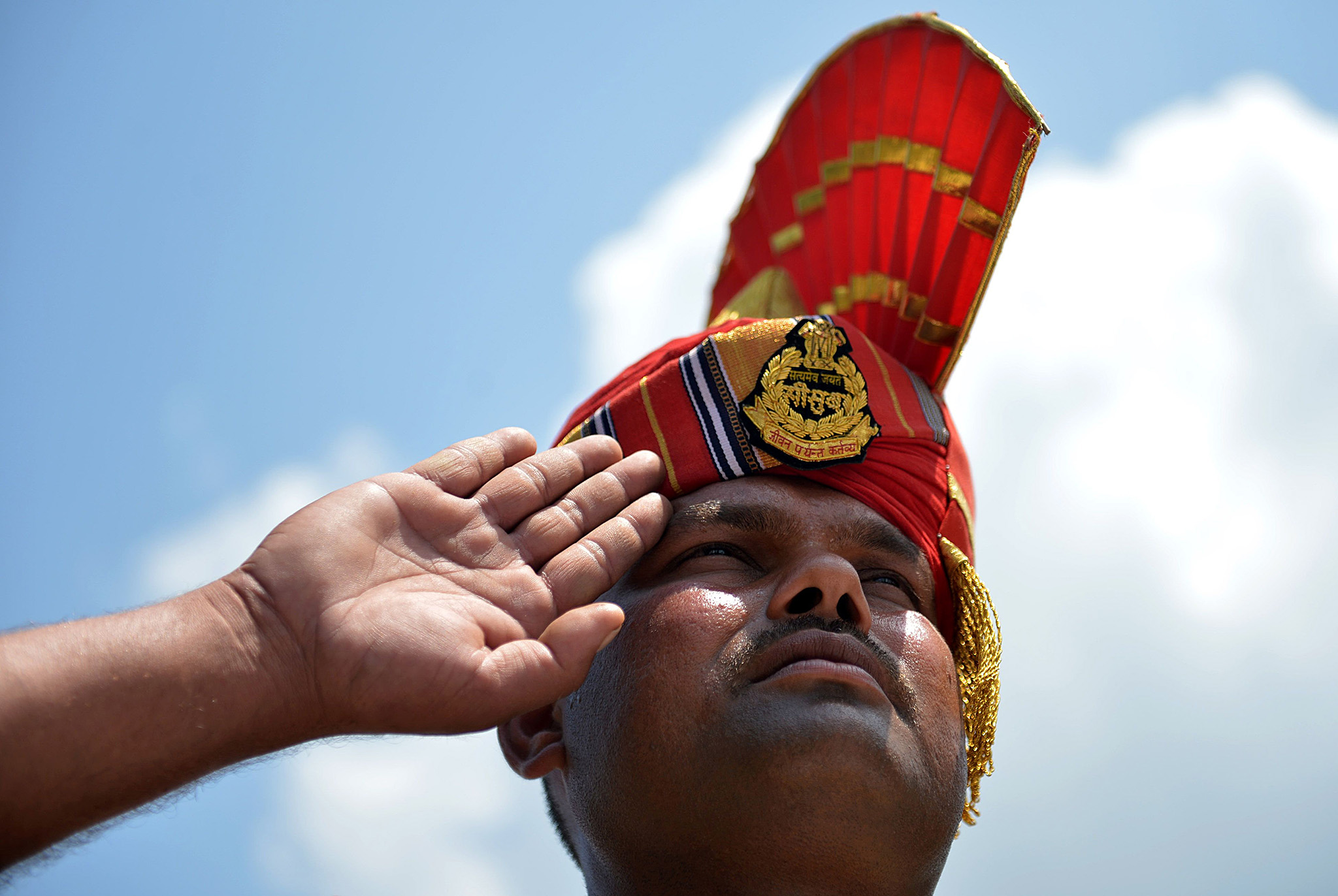 An Indian Border Security Force (BSF) soldier salutes near the coffins of three colleagues during a wreath-laying ceremony at BSF headquarters in Srinagar on August 9, 2016. At least three BSF soldiers and one suspected militant were killed in a gunfight close to the Line of Control in north Kashmirs Kupwara district on August 8. / AFP PHOTO / TAUSEEF MUSTAFATAUSEEF MUSTAFA/AFP/Getty Images
