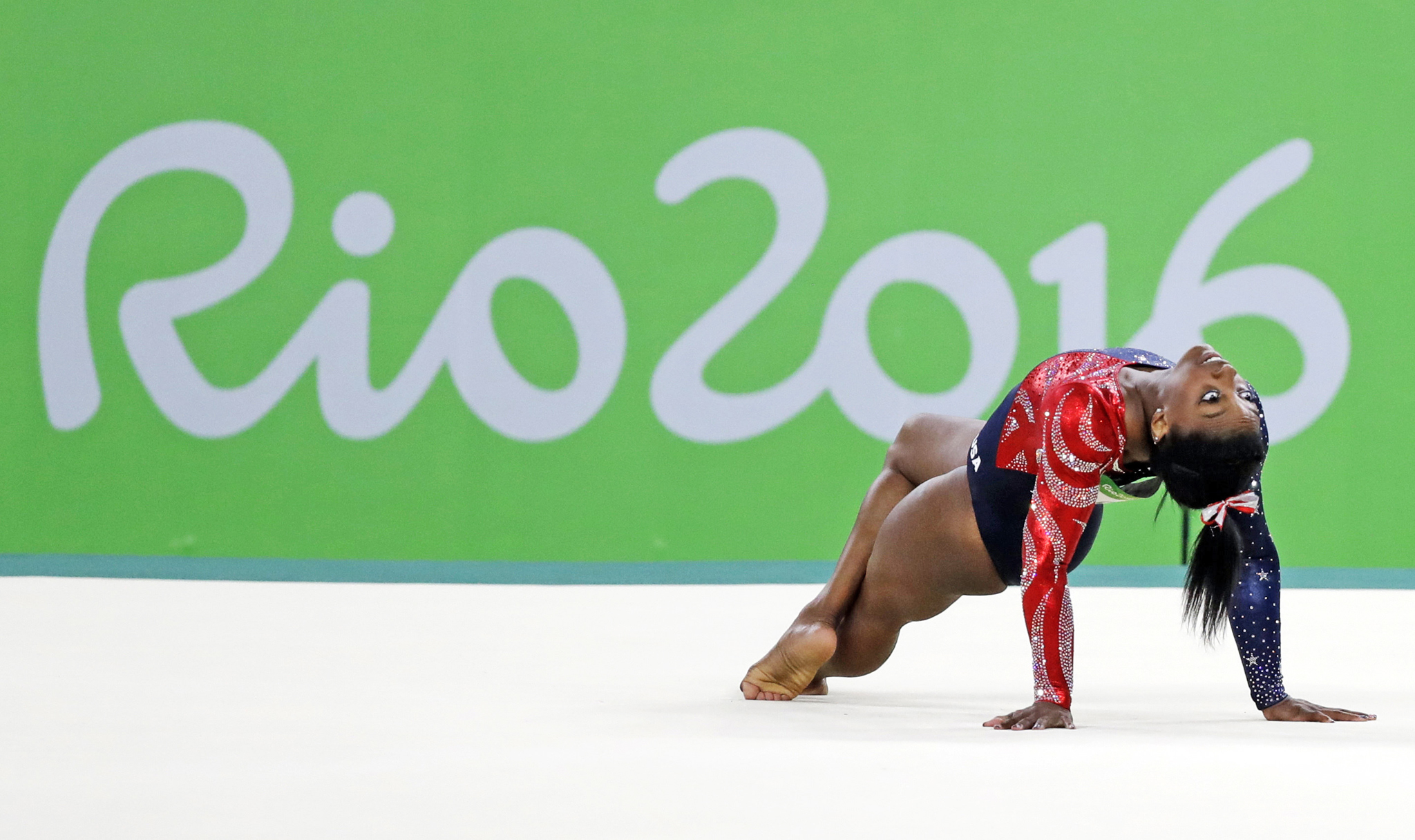 United States' Simone Biles performs on the floor during the artistic gymnastics women's qualification at the 2016 Summer Olympics in Rio de Janeiro, Brazil, Sunday, Aug. 7, 2016.