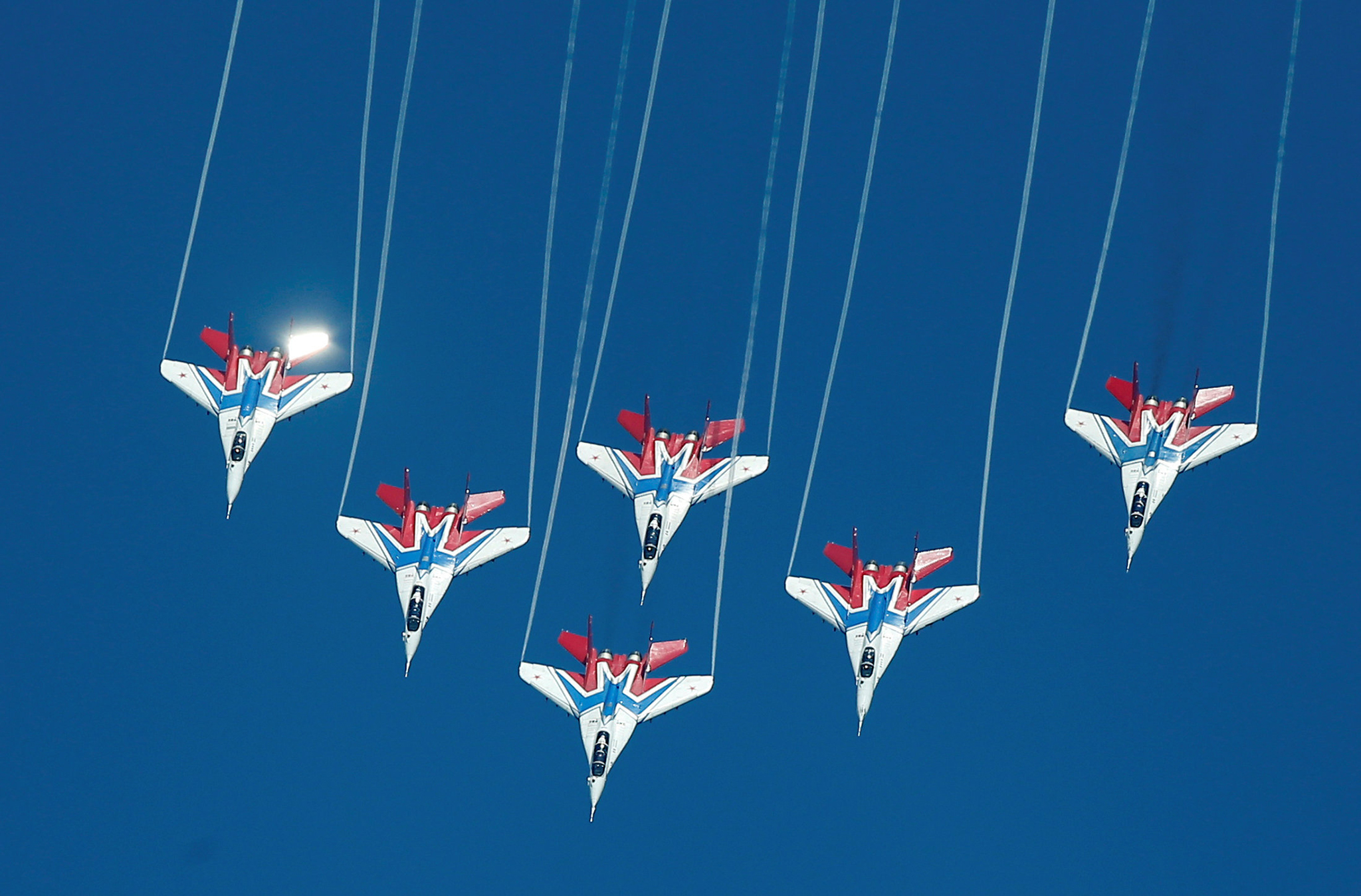 Mikoyan MiG-29 jet fighters of Strizhi aerobatic team fly in formation during International Army Games 2016 in Dubrovichi outside Ryazan