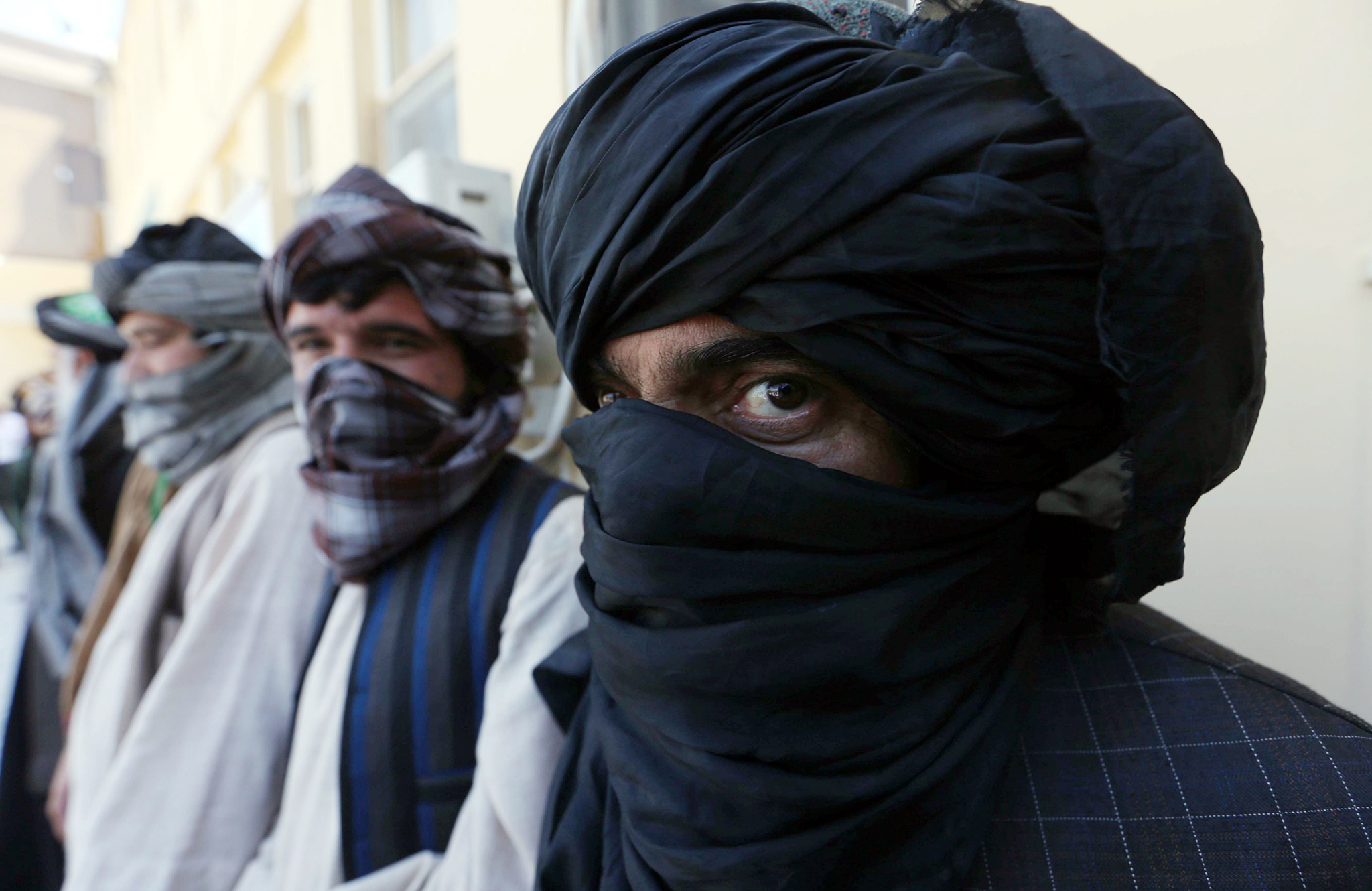 Former Taliban militants surrender their weapons during a reconciliation ceremony in Herat, Afghanistan, 03 August 2016. A group of 16 former Taliban militants on 03 August laid down their arms in Herat and joined the peace process. Under an amnesty launched by the former President Hamid Karzai and backed by the US in November 2004, hundreds of anti-government militants have so far surrendered to the government.