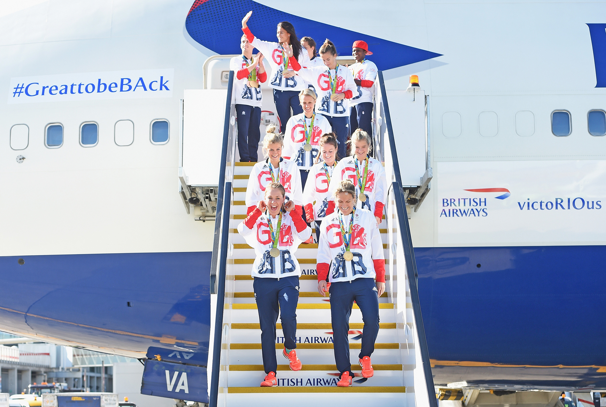 LONDON, ENGLAND - AUGUST 23:  Team GB athletes and members of the women's gold medal winning hockey team leave the aeroplane after arriving home at Heathrow Airport on August 23, 2016 in London, England. The 2016 British Olympic Team arrived back to Heathrow on a British Airways flight today having finished second in the medal table at the Rio Olympics. They totalled 67 medals including 27 Gold and 23 Silver in Great Britain's strongest Olympic performance in over a century.