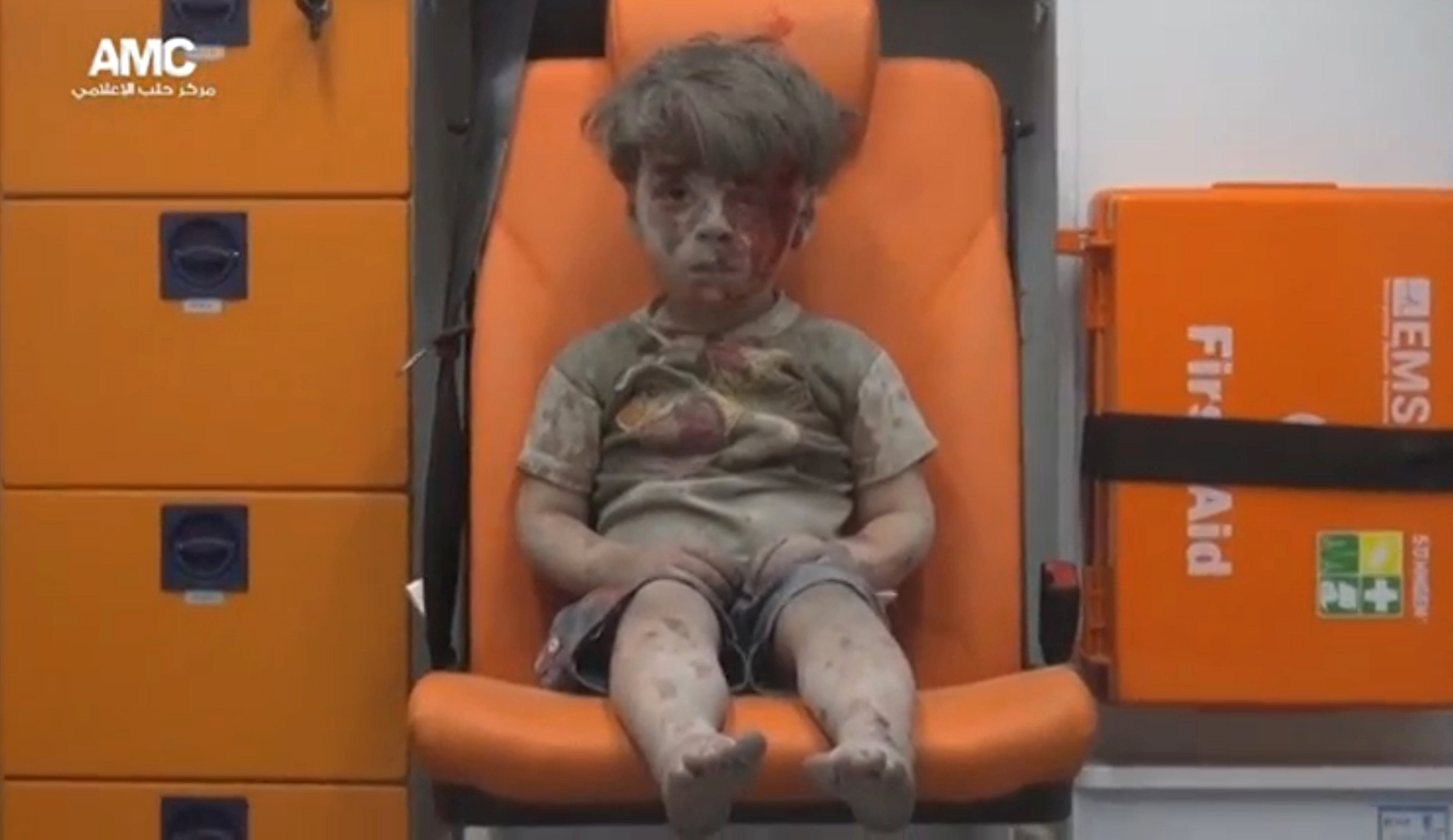 A still image taken on August 18, 2016 from a video posted on social media said to be shot in Aleppo on August 17, 2016, shows a boy with bloodied face sitting in an ambulance, after an airstrike, Syria