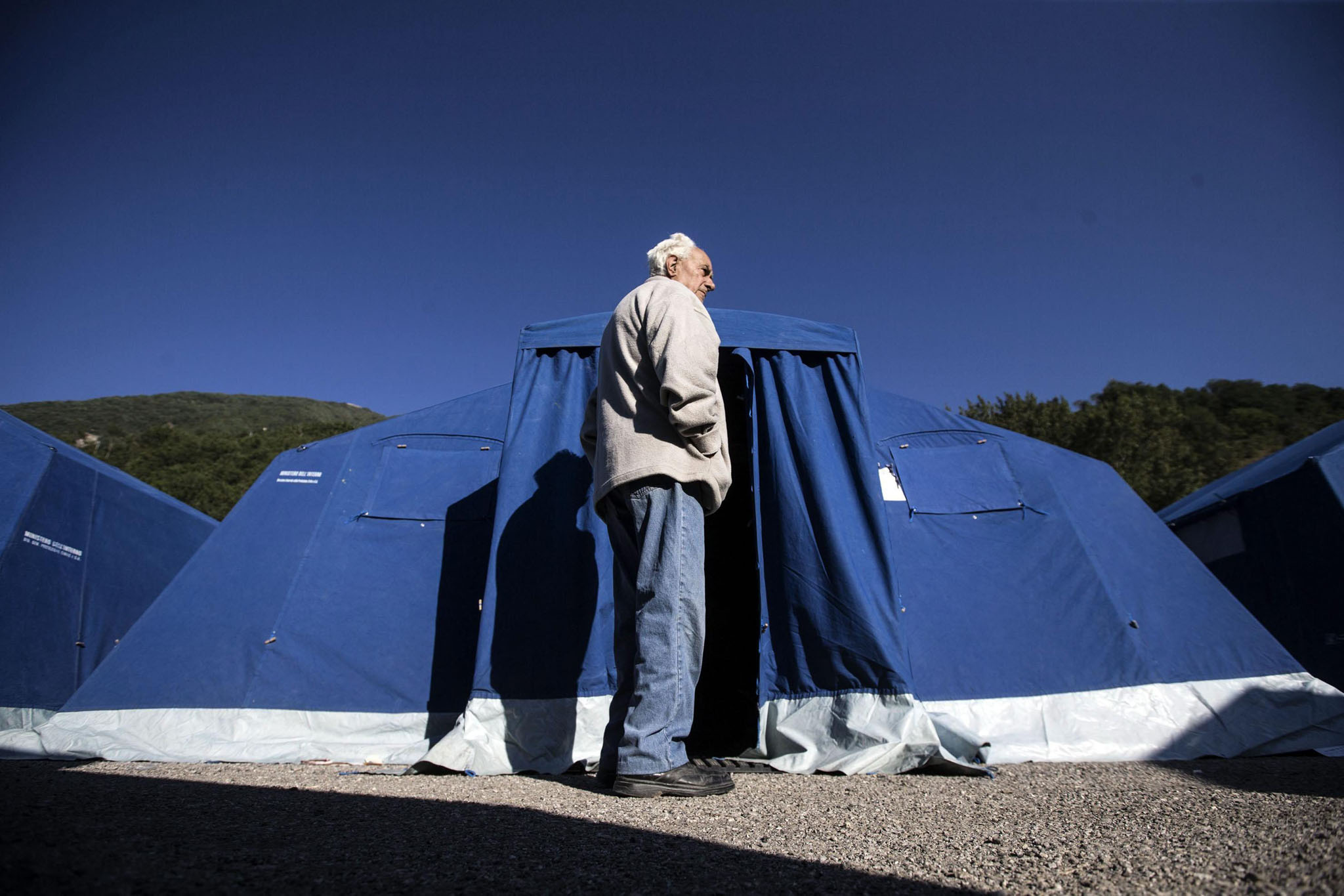 A man is seen in front of a tent in a temporary shelter for the earthquake victims in Amitrice, Italy
