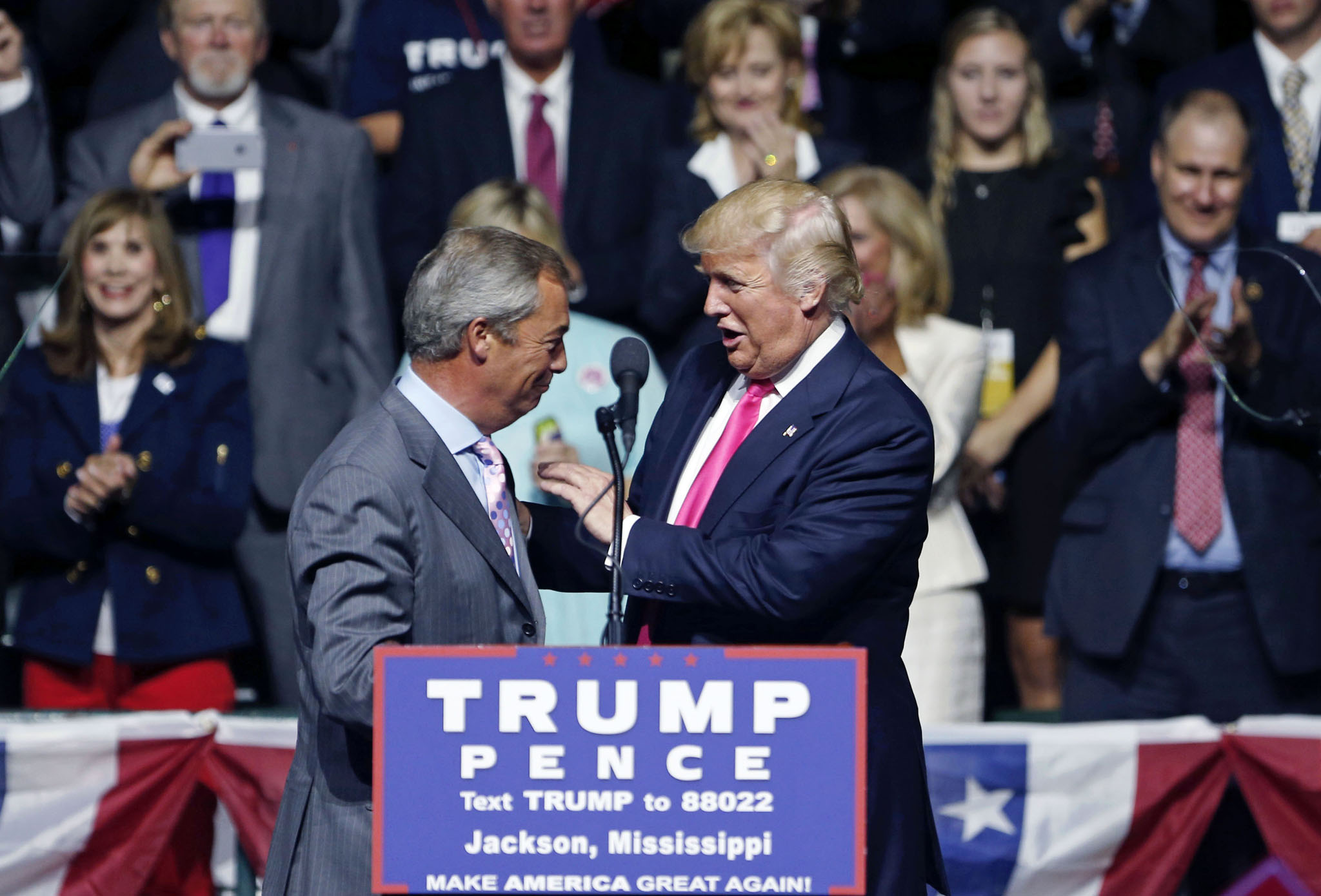 Republican presidential candidate Donald Trump welcomes Nigel Farage, ex-leader of the British UKIP party, to speak at a campaign rally in Jackson, Miss