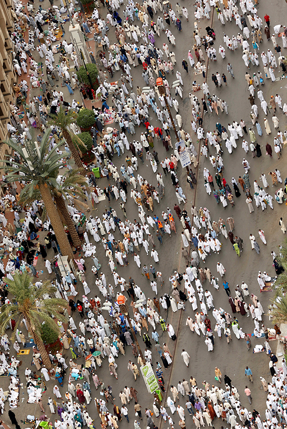 Muslim pilgrims walk after Friday prayers at the Grand mosque in Mecca September