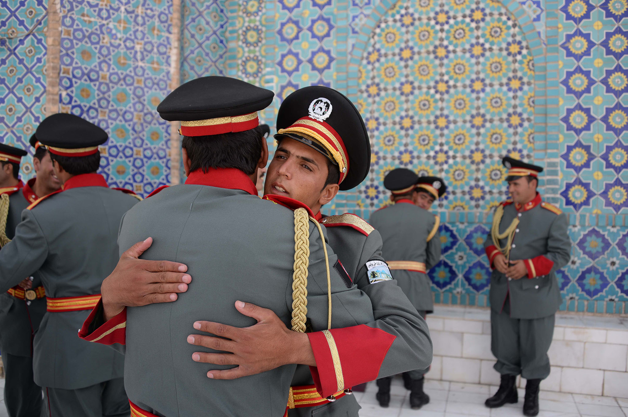 "Members of an Afghan guard of honour greet each other after offering Eid-al-Adha prayers at the Hazrat-i- Ali shrine in Mazar-i Sharif on September 12, 2016. Afghans started celebrating Eid al-Adha or ""Feast of the Sacrifice"", which marks the end of the annual hajj or pilgrimage to Mecca and is celebrated in remembrance of Abraham's readiness to sacrifice his son to God. / AFP PHOTO / FARSHAD USYANFARSHAD USYAN/AFP/Getty Images"