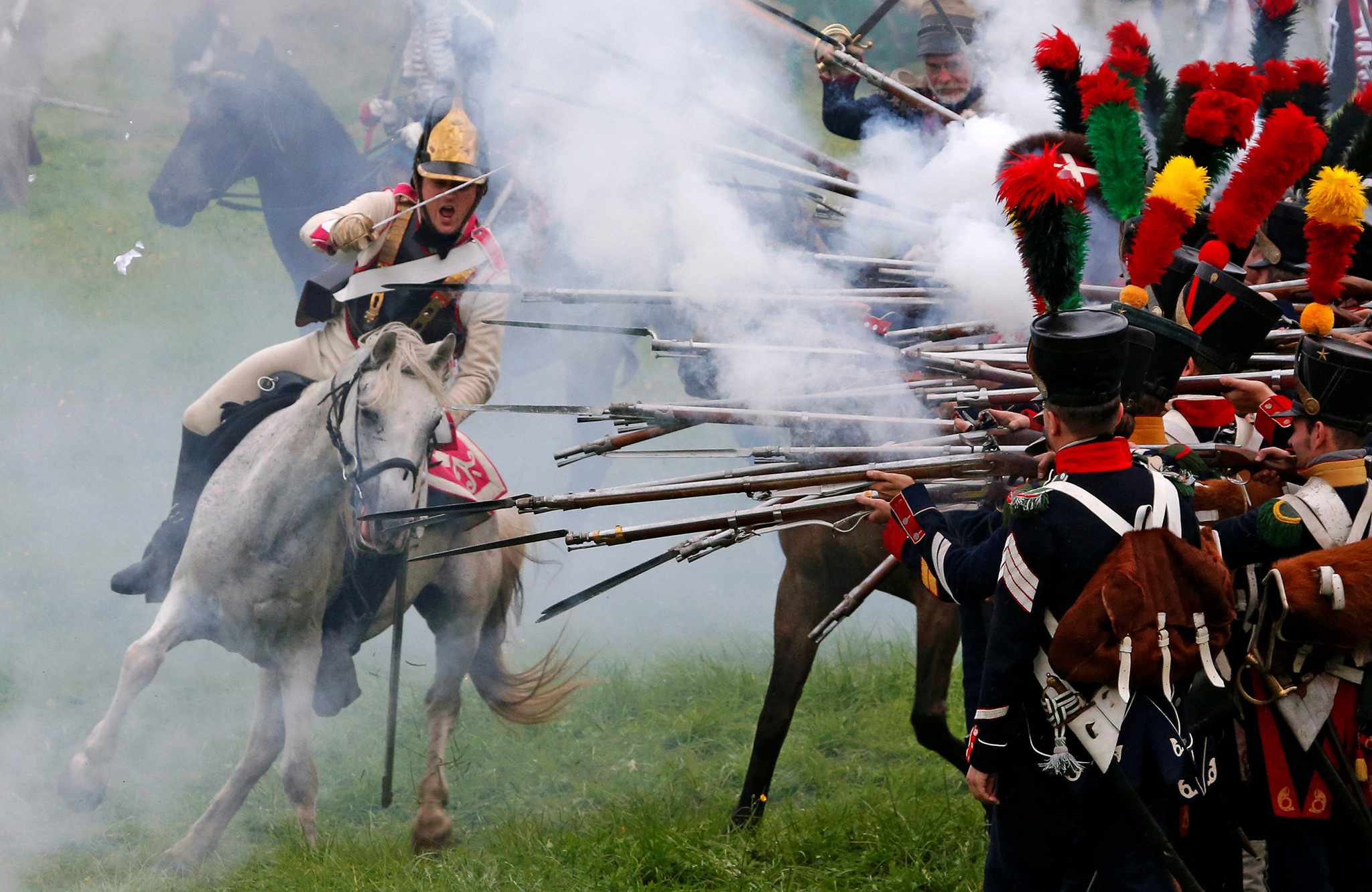 Participants reenact the 1812 Battle of Borodino between Russia and the invading French army during anniversary celebrations near Moscow, Russia