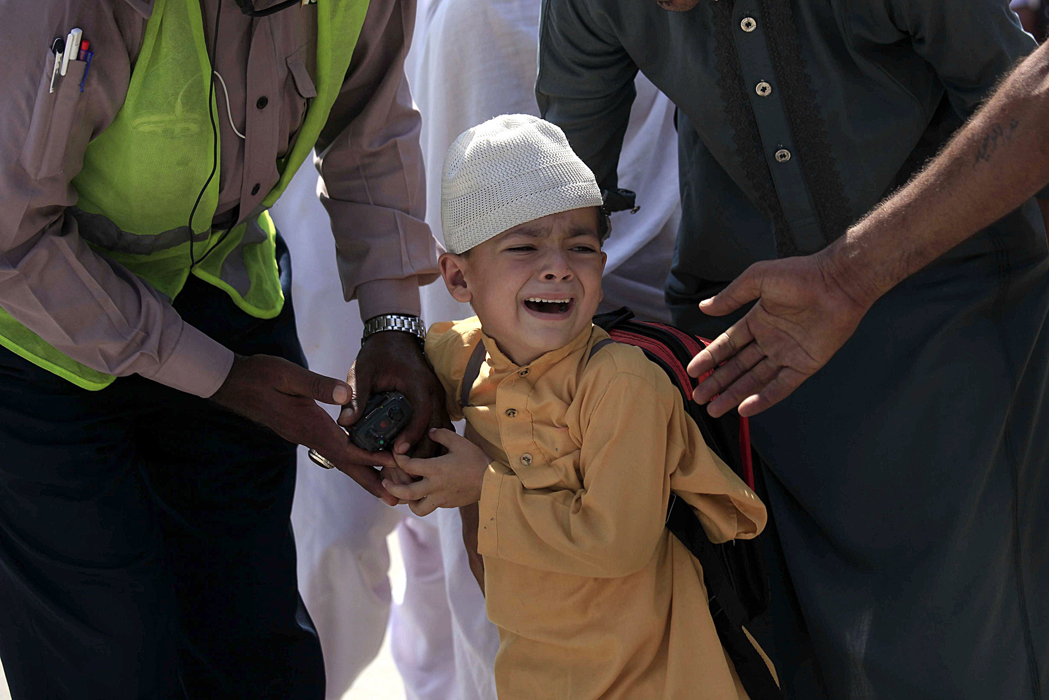 A school boy cries following a bomb blast targeting a Christian colony in the Khyber Pakhtunkhwa provincial capital of Peshawar, Pakistan, 02 September 2016. According to media reports, four suicide bombers were shot dead by security forces after they targeted a Christian neighborhood near Peshawar, one person was killed in this incident. In another incident a suicide bomber has targeted a court in Mardan, where 11 people were killed and 30 other were wounded.  EPA/BILAWAL ARBAB  EPA/BILAWAL ARBAB