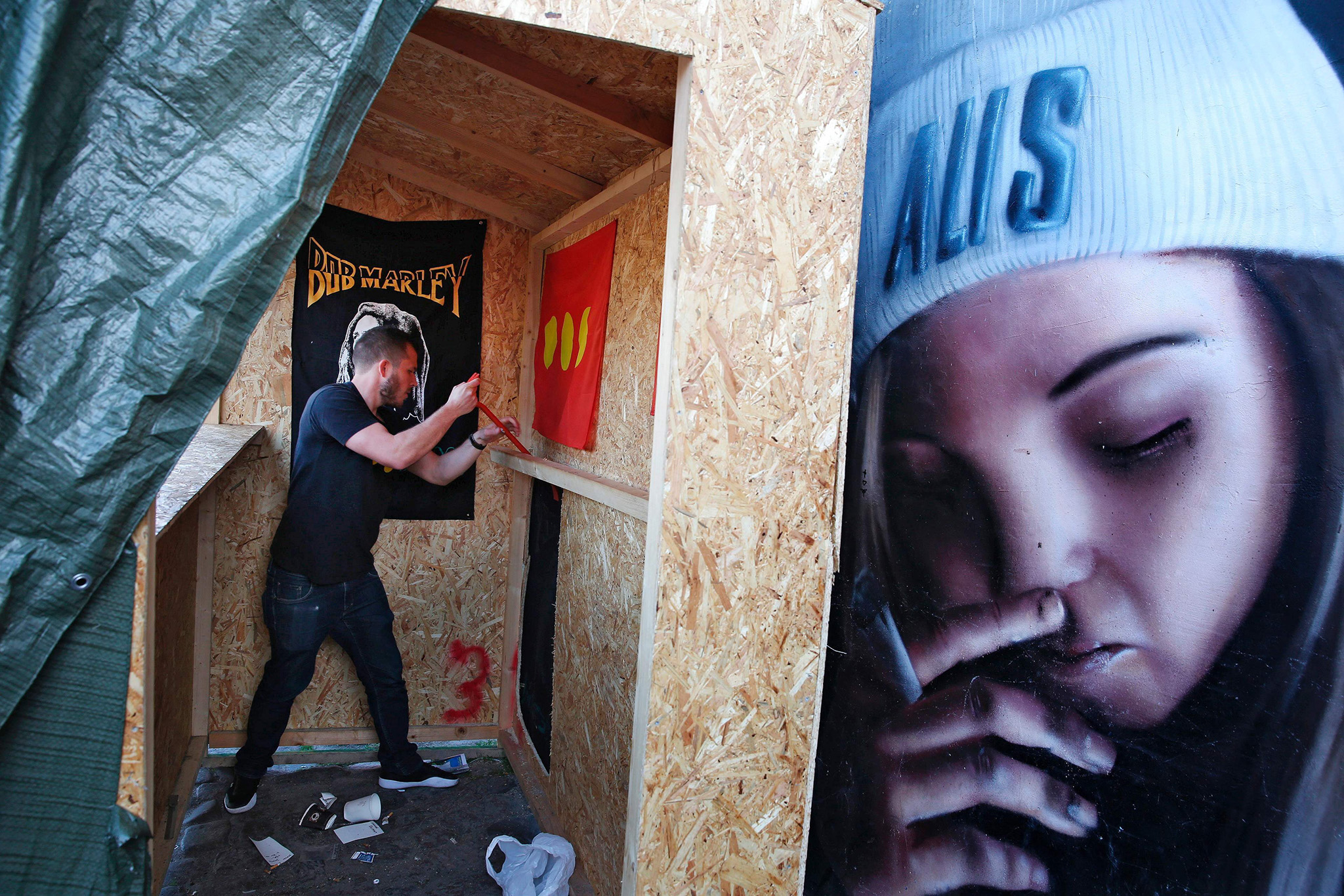 A resident clears out the hash vending stalls in the Freetown Christiania neighborhood of Copenhagen,