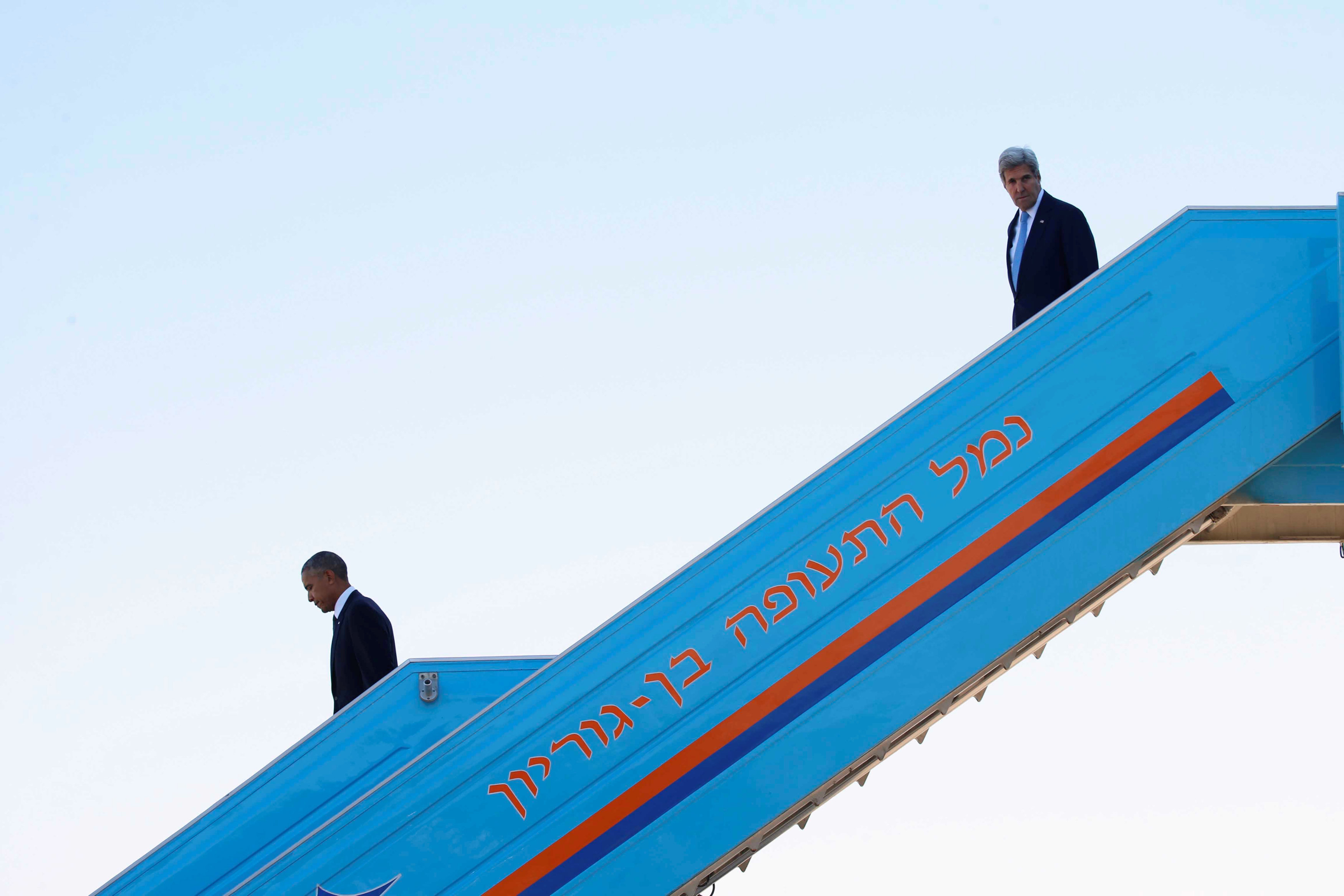 U.S President Barack Obama (L) and U.S. Secretary of State John Kerry disembark Air Force One upon landing at Israel's Ben Gurion International airport to attend the funeral of former Israeli President Shimon Peres, in Lod, Israel September 30, 2016.