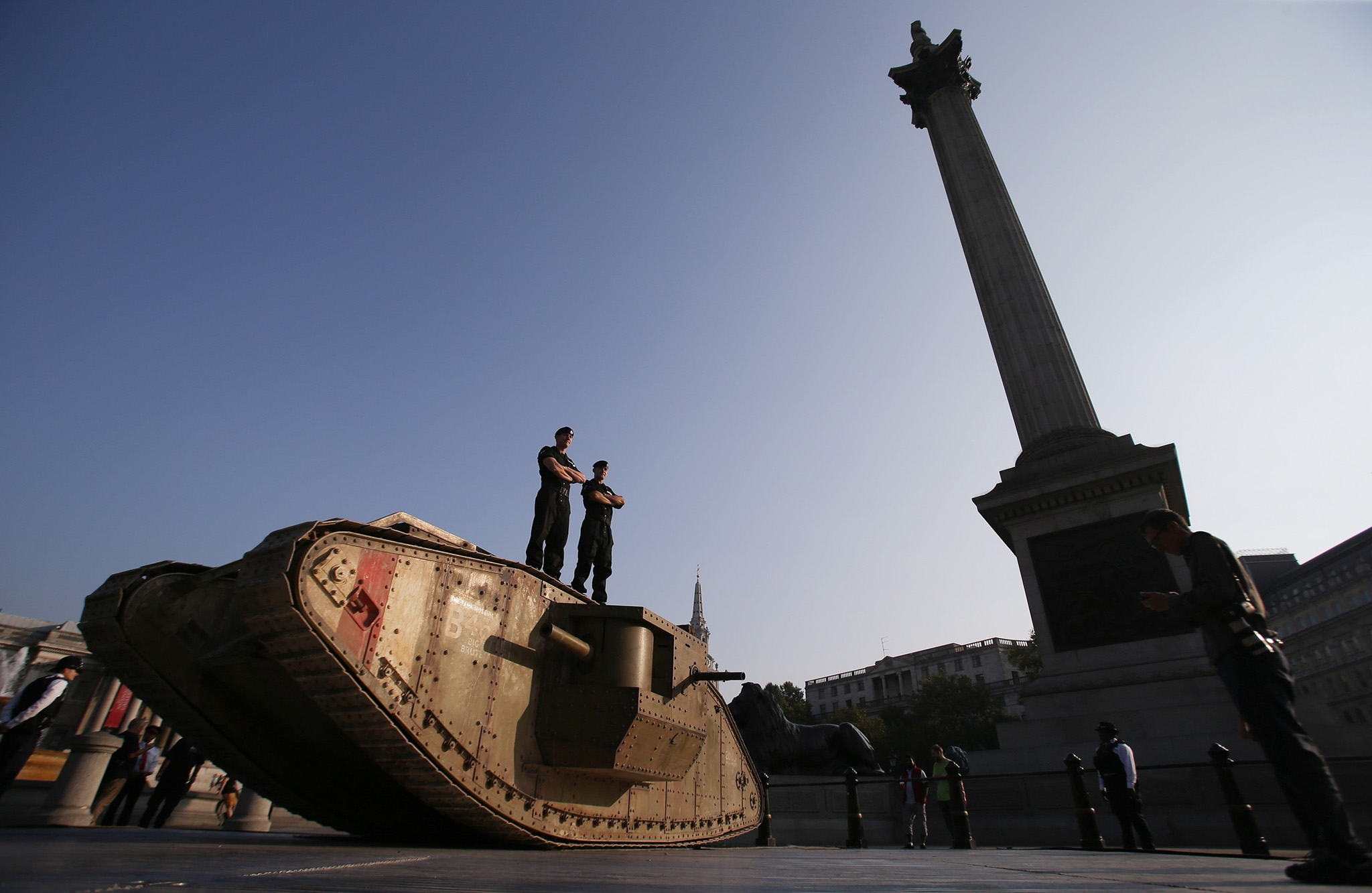 Members of the Royal Tank Regiment stand on a replica First World War Mark IV tank in London's Trafalgar Square marking the centenary of an armoured vehicle's first-ever deployment during the Battle of the Somme. PRESS ASSOCIATION Photo. Picture date: Thursday September 15, 2016. Photo credit should read: Daniel Leal-Olivas/PA Wire