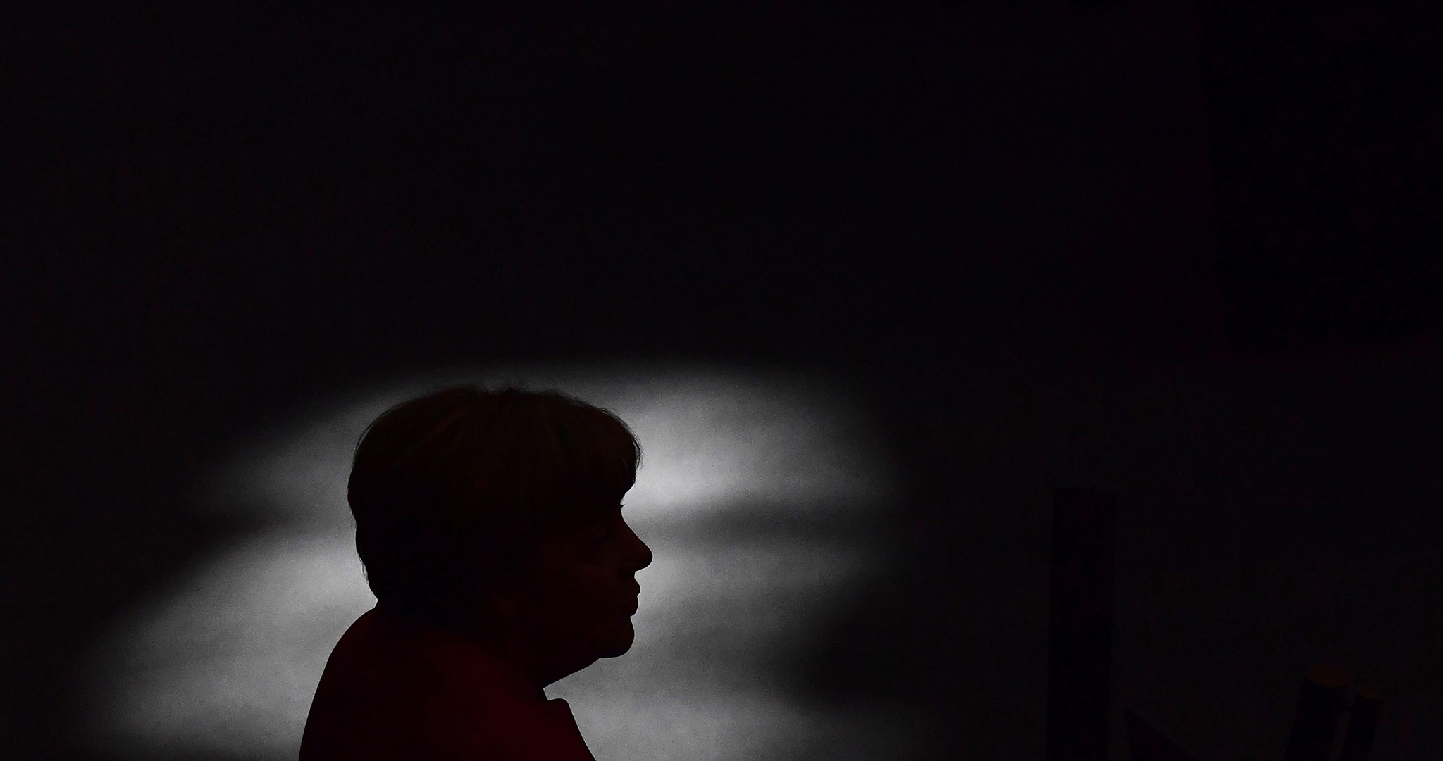 German Chancellor Angela Merkel is silhouetted as she gives a speech during a session of the German Bundestag (lower house of parliament) in Berlin on September 7, 2016. / AFP PHOTO / TOBIAS SCHWARZTOBIAS SCHWARZ/AFP/Getty Images