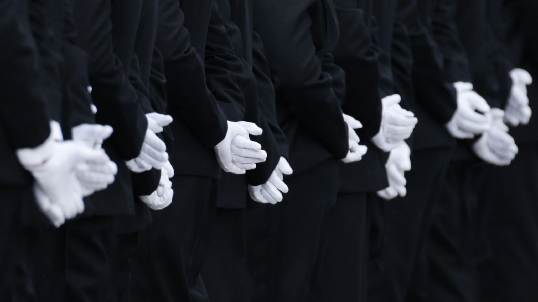 The gloved hands of new recruits taking part in the Metropolitan Police Service's first passing-out parade on the redeveloped grounds at the Peel Centre in Hendon, north London. PRESS ASSOCIATION Photo. Picture date: Friday September 9, 2016. Photo credit should read: Yui Mok/PA Wire