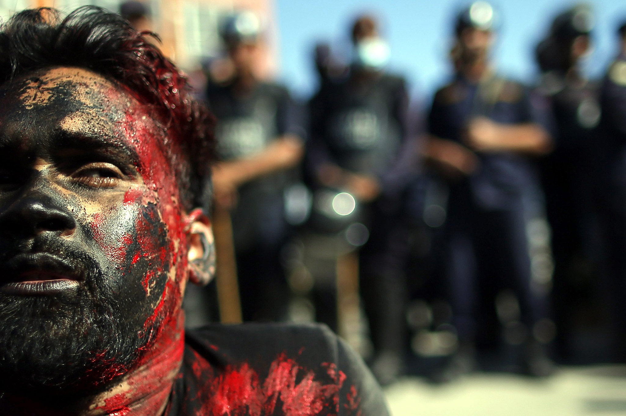 Artist belonging to Nepalese ethnic-based Madhesh political parties acts as an injured activist while protesting to mark the Nepal's first constitution day in Kathmandu, Nepal, 19 September 2016. Hundreds of members of Ethnic Madhesi political parties and related artists protest against the new constitution, which is celebrating by the government side on 19 September 2016. Madhesh based political parties say that this new constitution will not represent their demands which obstructs more political representation for ethnic minorities in the nation's parliament.  EPA/NARENDRA SHRESTHA