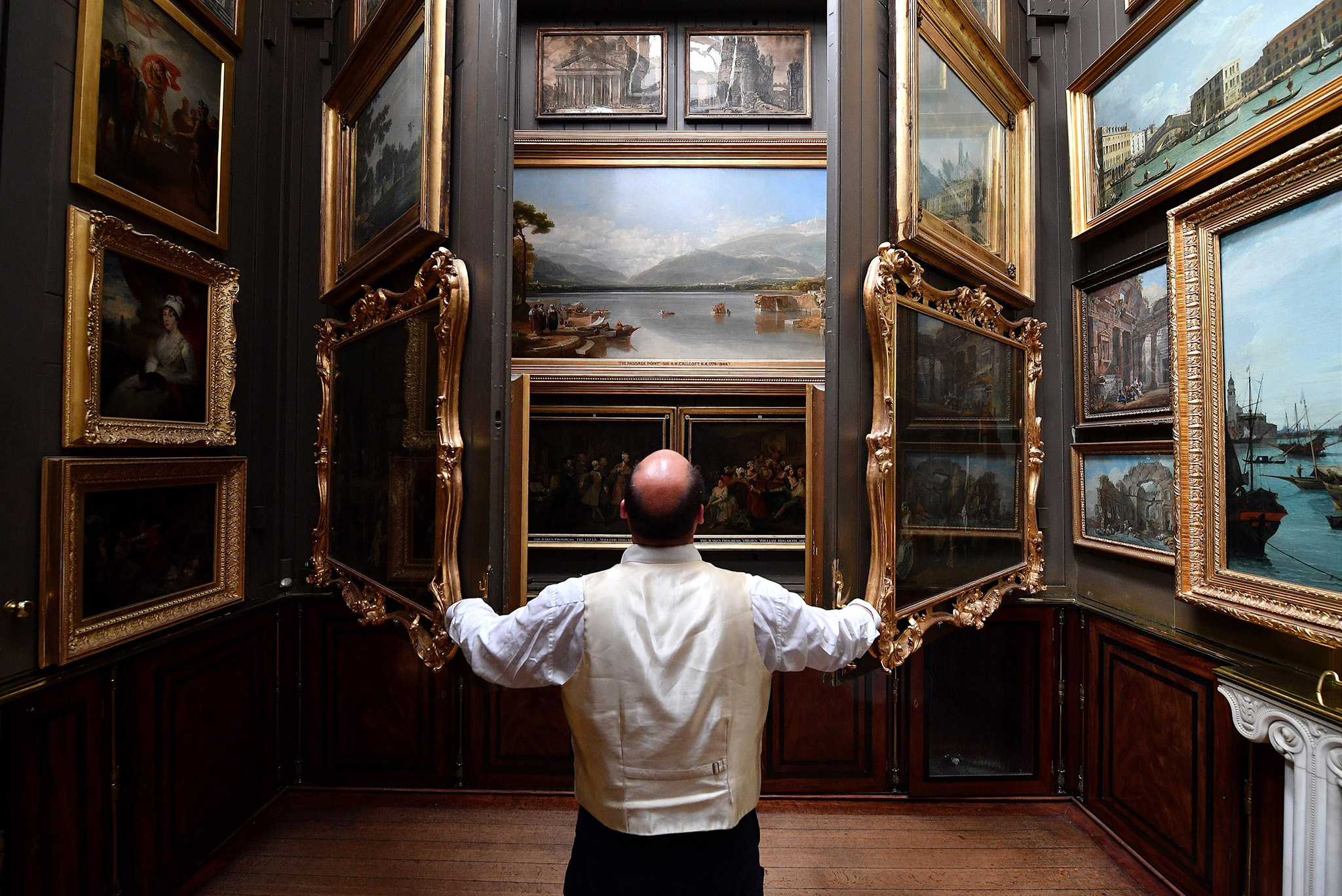 Visitor Assistant Jonty Stern poses in The Picture Room of The Sir John Soanes Museum on September 12, 2016 in London, England. The museum has recently undergone a seven year, £7million restoration with new areas opened to the public for the first time, allowing 10% more of the collection to now be displayed.  (Photo by Leon Neal/Getty Images)***BESTPIX***
