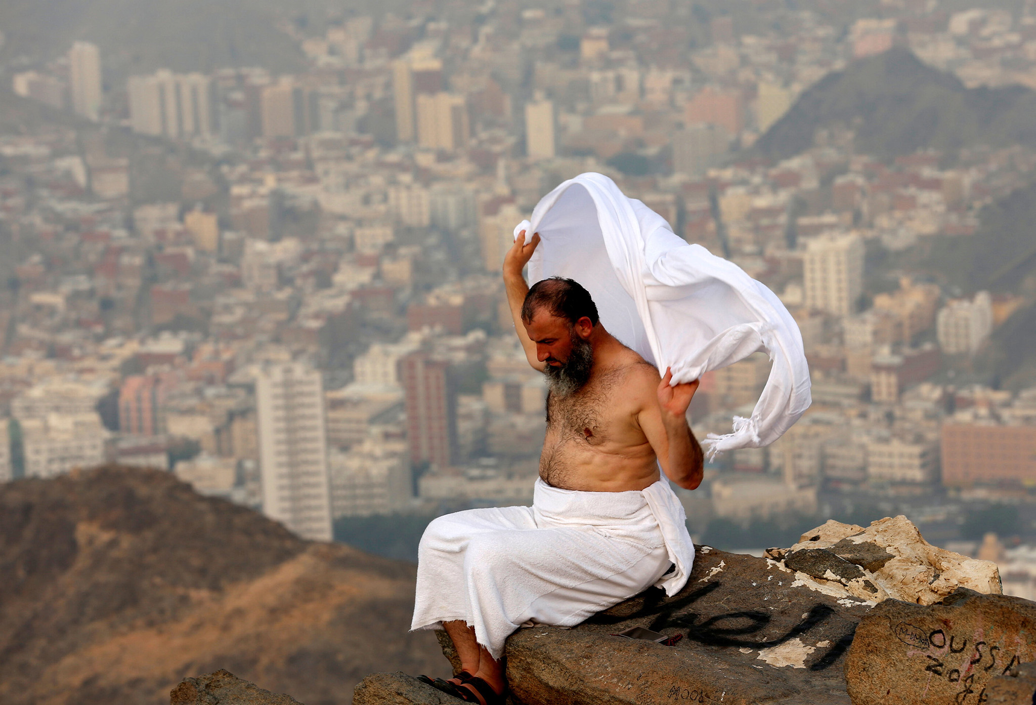 A Muslim pilgrim sits on the top of Mount Al-Noor, where Muslims believe Prophet Mohammad received the first words of the Koran through Gabriel in the Hera cave, ahead of the annual haj pilgrimage in the holy city of Mecca, Saudi Arabia September 7, 2016. REUTERS/Ahmed Jadallah