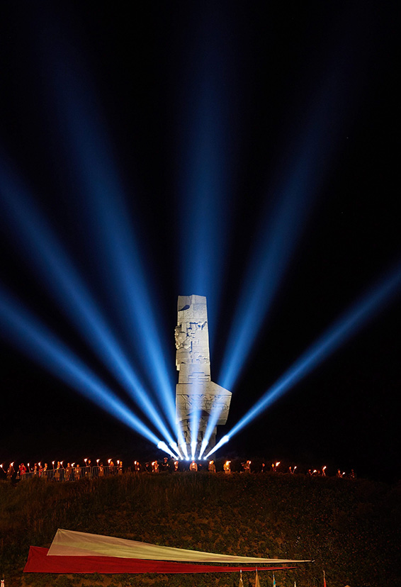 Light flares are seen at the Monument to the Defenders of Westerplatte during the ceremony marking 77th anniversary of World War II outbreak in Westerplatte, in Gdansk, Poland, 01 September 2016. World War II began when the German Navy destroyer 'Schleswig-Holstein' fired the first shots on the Westerplatte fortifications at 04:45 hrs on 01 September 1939.  EPA/ADAM WARZAWA POLAND OUT