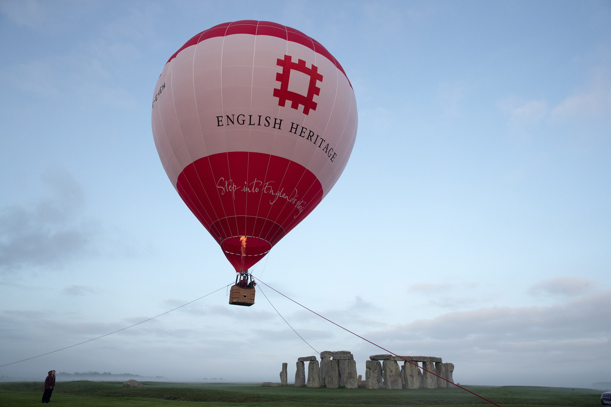 A tethered hot air balloon flies over the ancient neolithic monument of Stonehenge near Amesbury on September 7, 2016 in Wiltshire, England.  To mark the 30th anniversary of Stonehenge becoming a World Heritage Site, English Heritage has launched a competition offering members of the public the chance of a hot balloon ride which allows the chance to see a  unique view of Stonehenge within in a wider prehistoric landscape but also the see the recent changes to its setting in recent years including the removal of the A344 and the old car park.  (Photo by Matt Cardy/Getty Images)