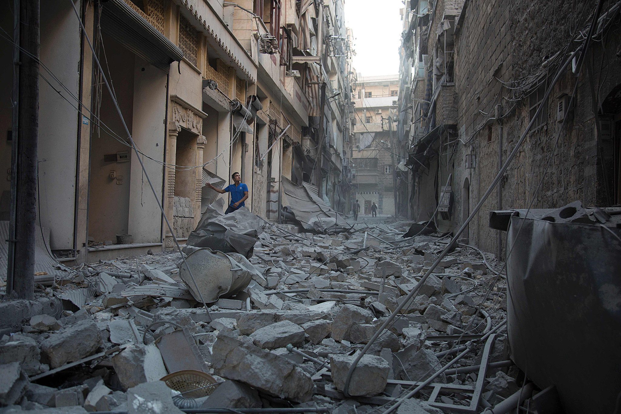 A Syrian man stands in the rubble of destroyed buildings following an air strike in Aleppo's rebel-controlled neighbourhood of Karm al-Jabal on September 18, 2016. Syria's ceasefire was on the brink of collapsing on September 18, after a US-led coalition strike killed dozens of regime soldiers and Aleppo city was hit by its first raids in nearly a week. / AFP PHOTO / KARAM AL-MASRIKARAM AL-MASRI/AFP/Getty Images