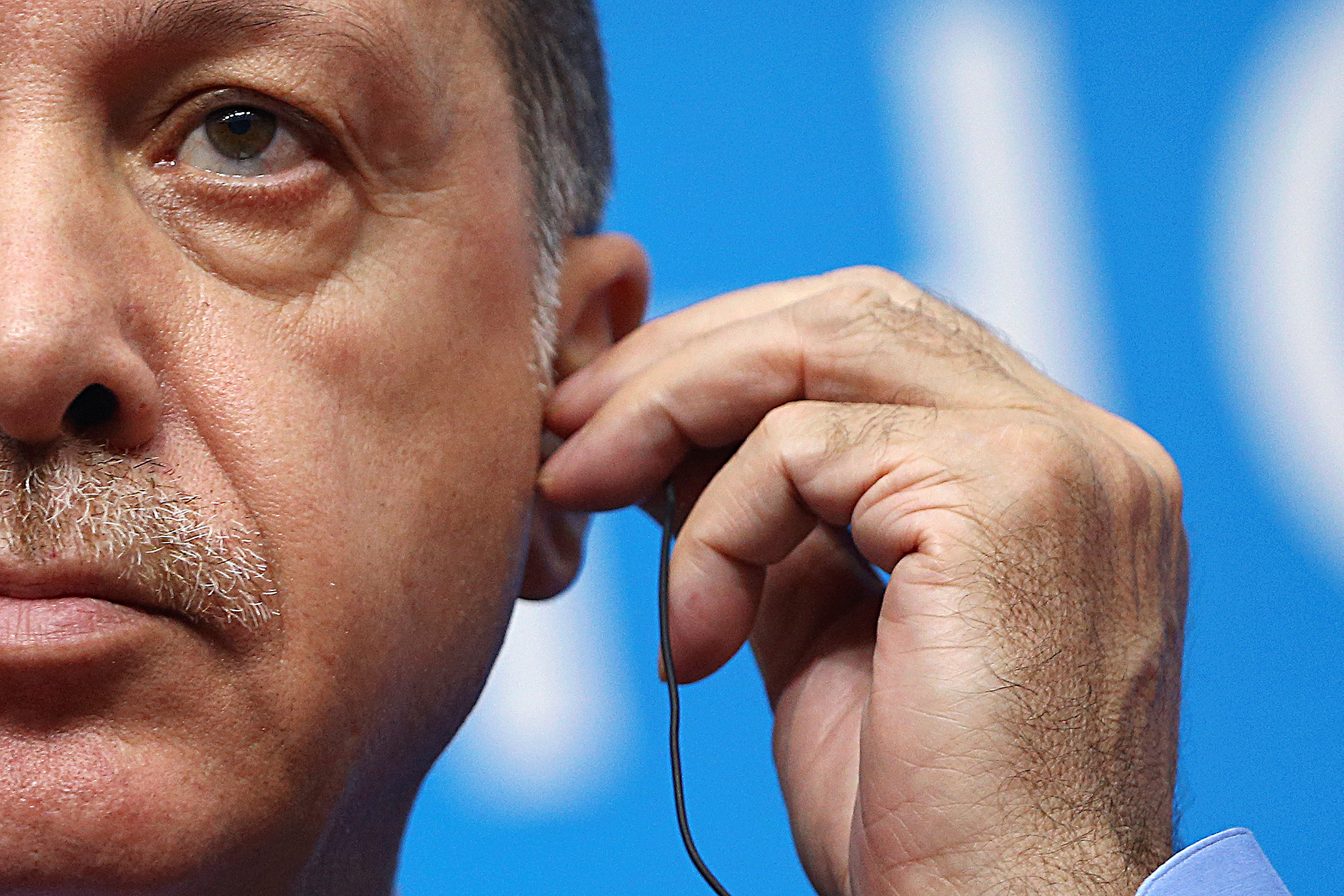Turkey's President Tayyip Erdogan adjusts earphones during a news conference after the closing of G20 Summit in Hangzhou, Zhejiang Province, China, September 5, 2