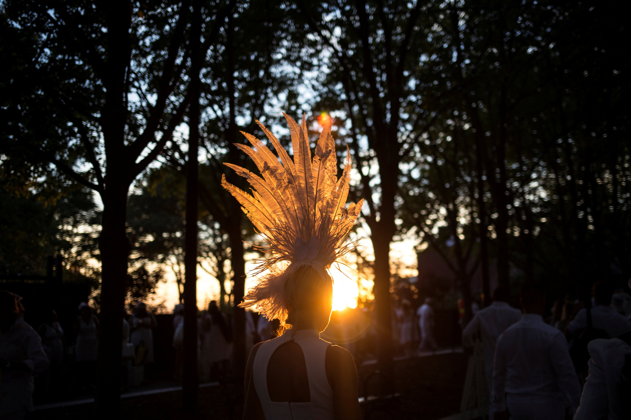 People attend Diner En Blanc, the French-inspired secret pop-up dinner, in Robert F. Wagner Jr. Park, in New York, U.S