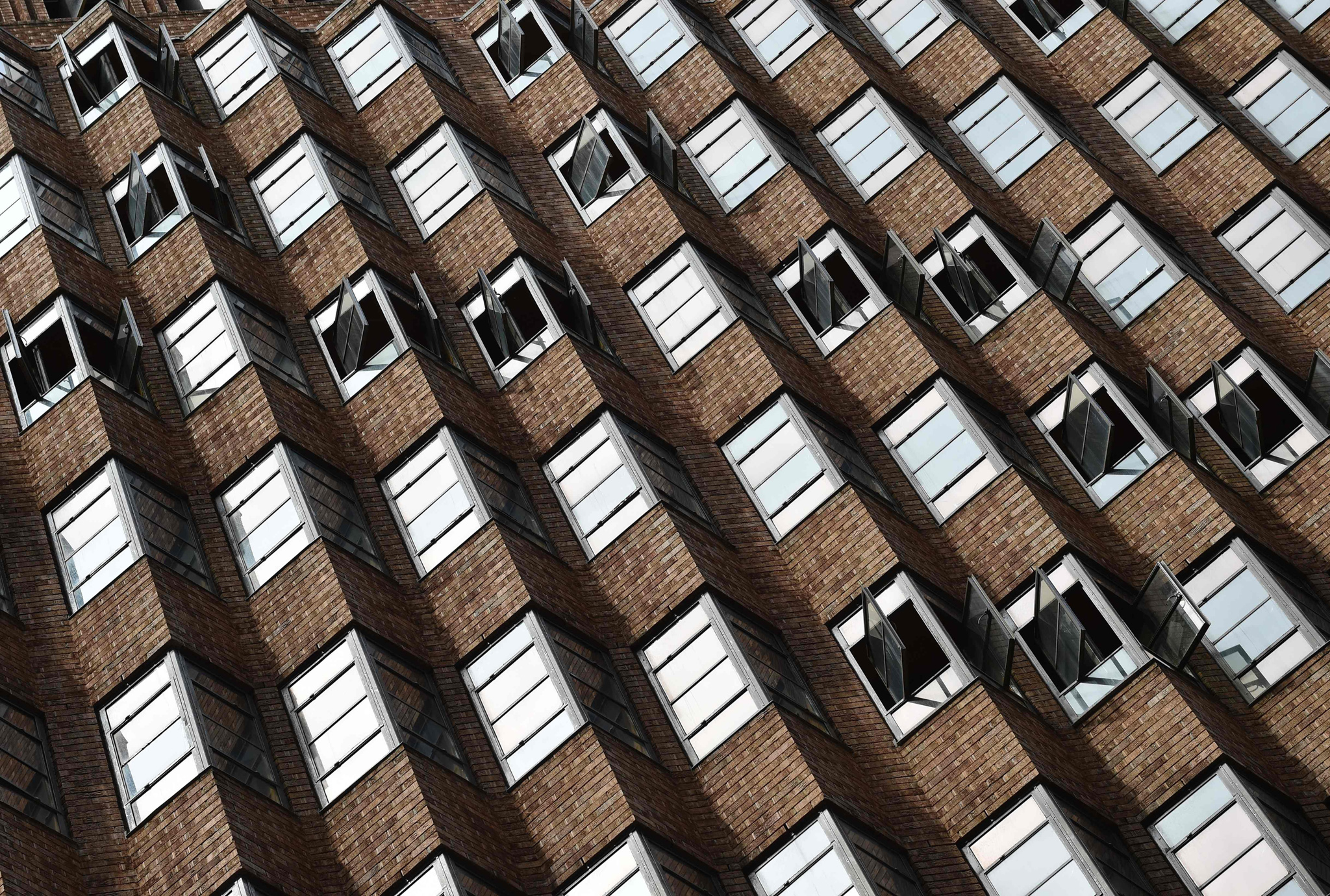 Windows are opened in a high rise building as mild spring weather arrives in Sydney