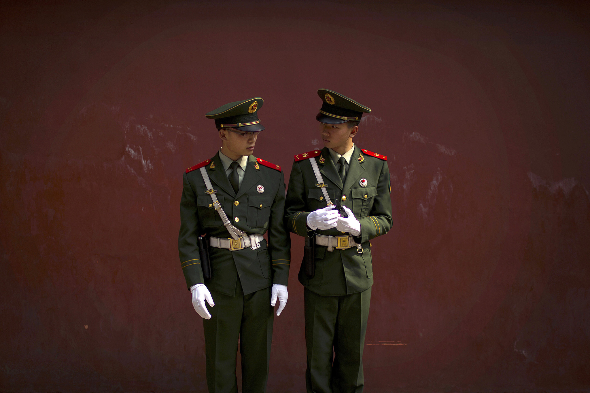 A pair of Chinese paramilitary policemen keep watch at a park in Beijing, Monday, Oct. 3, 2016. Saturday was China's National Day holiday, the start of a weeklong holiday period during which millions of Chinese travel and visit tourist sites. (AP Photo/Mark Schiefelbein)